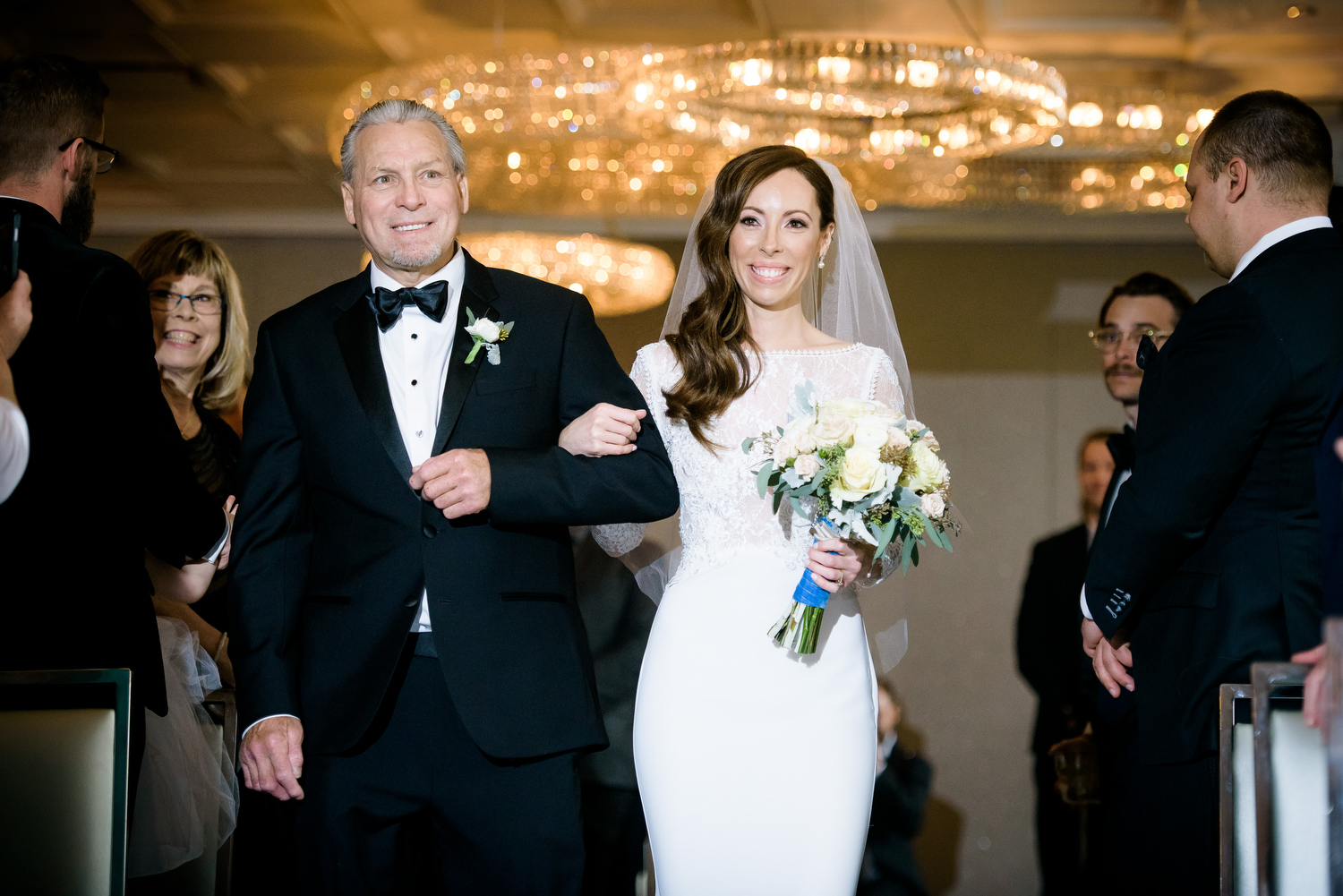 Father of the bride and his daughter walk down the aisle during a Thompson Chicago wedding.