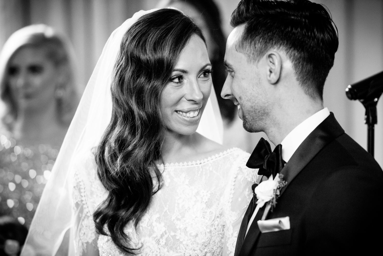 Bride and groom share a moment during their Thompson Chicago wedding ceremony.