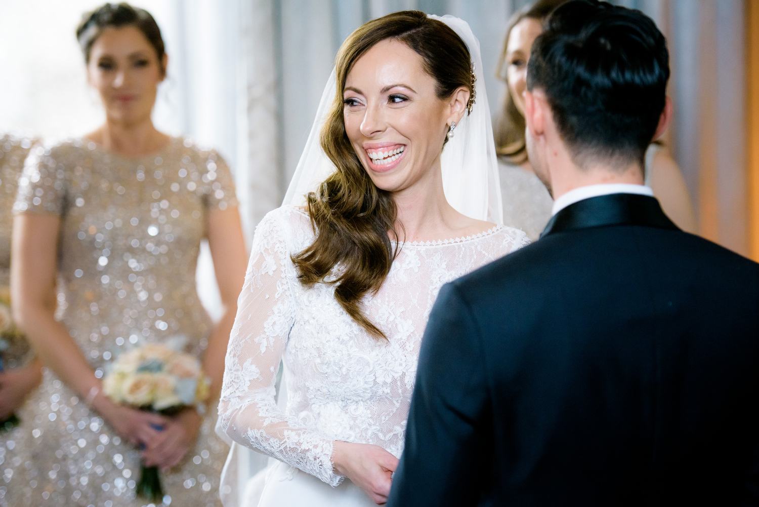Bride and groom share a laugh during their Thompson Chicago wedding ceremony.