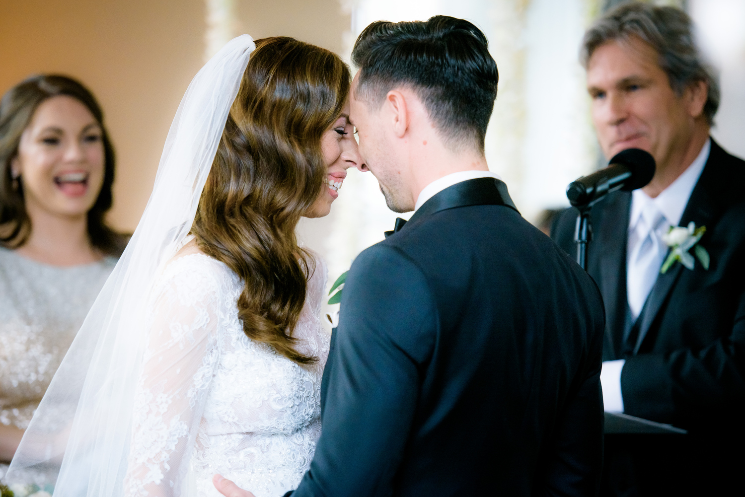 Tender moment between bride and groom during their Thompson Chicago wedding.