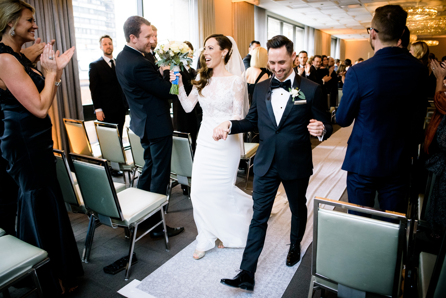 Bride and groom walk down the aisle after getting married at the Thompson Chicago.