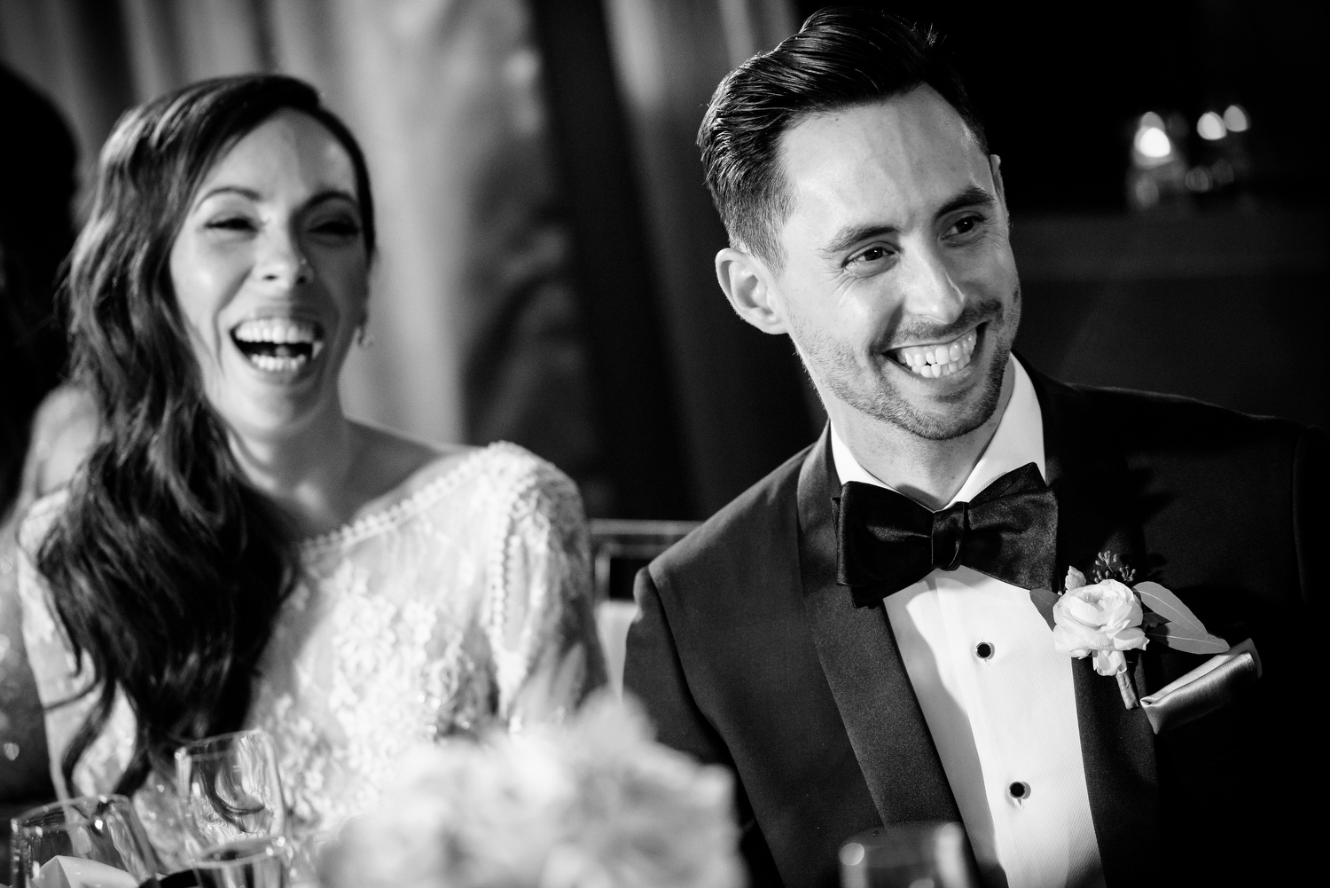 Bride and groom laugh with guests during their Thompson Chicago wedding ceremony.