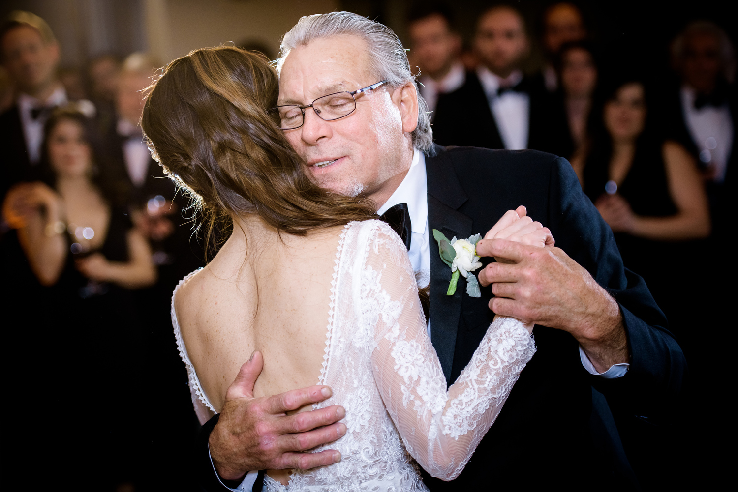 Emotional father-daughter dance during a Thompson Chicago wedding reception.
