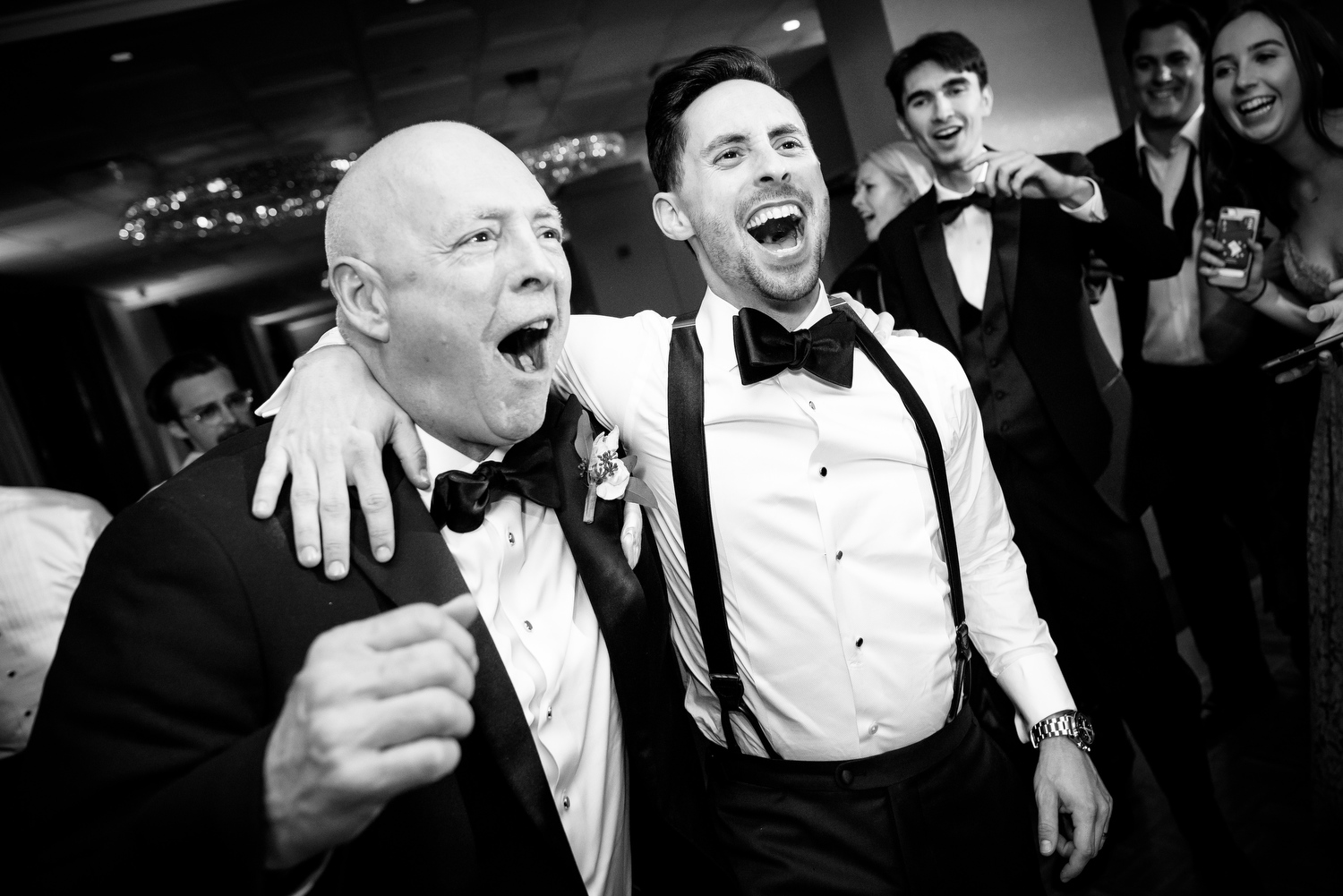 Groom and his father on the dance floor during a Thompson Chicago wedding reception.