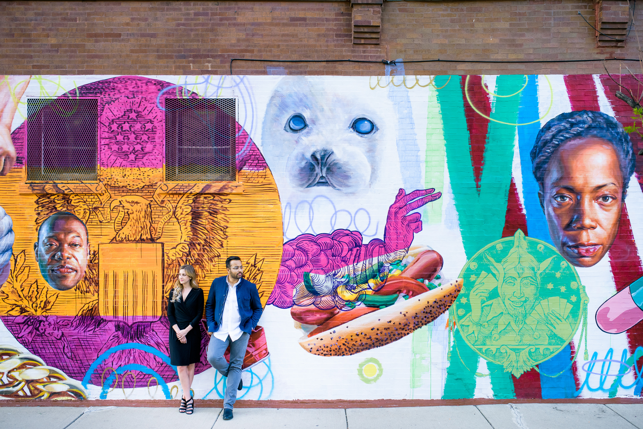 Humboldt Park Chicago engagement session in front of a street art mural.