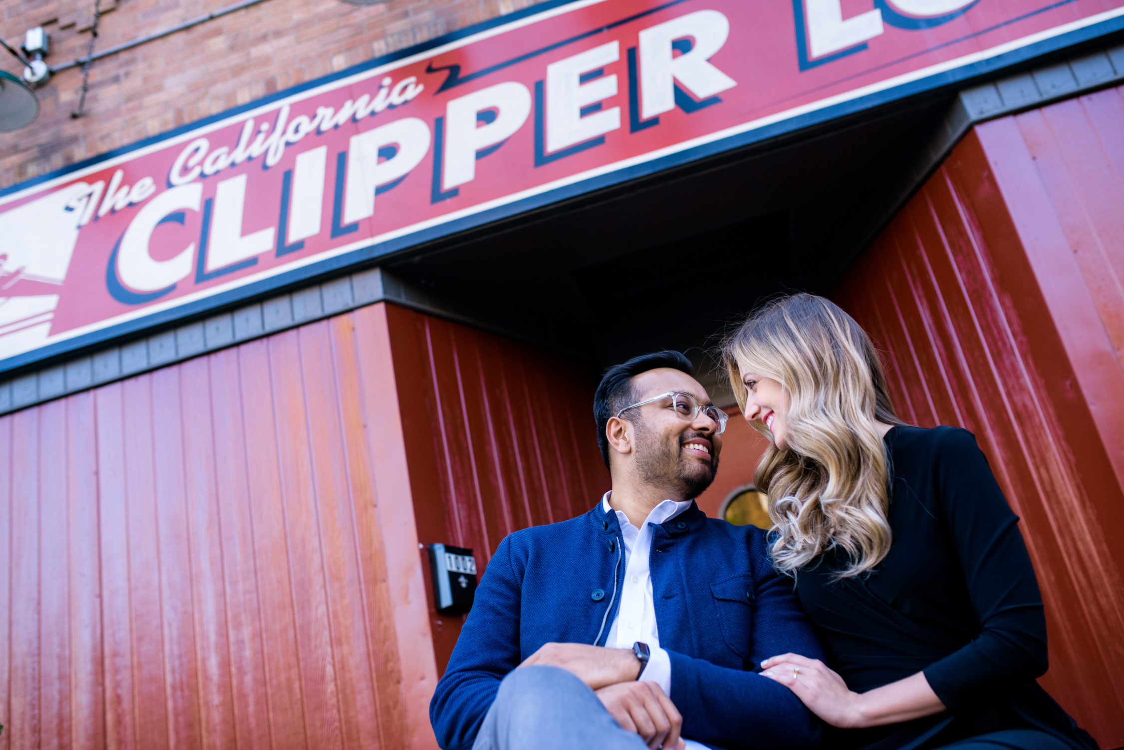 Engagement photo outside the California Clipper Lounge in Humboldt Park Chicago.