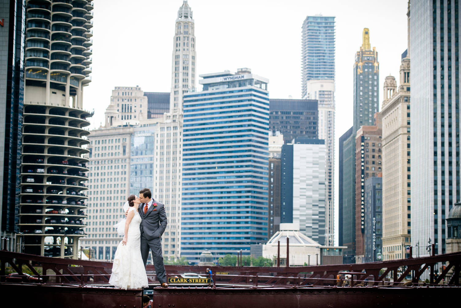 Wedding photo of bride and groom on a bridge over the Chicago river.