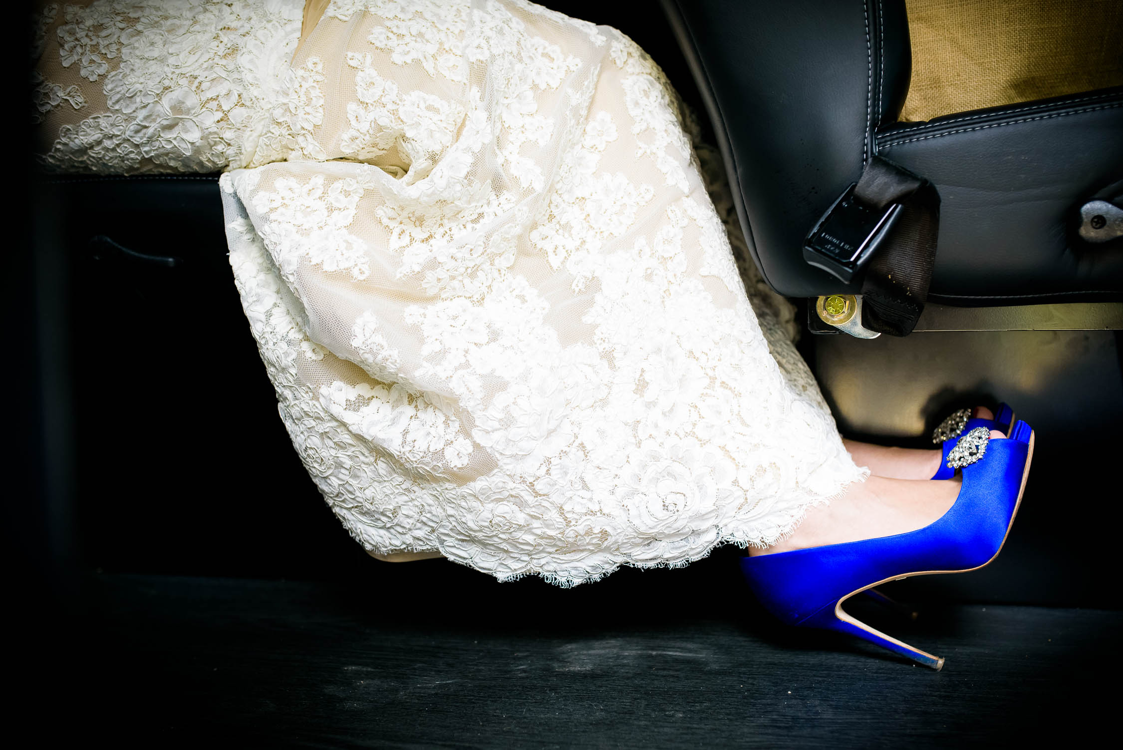 Creative detail photo of the bride's shoes during a University of Chicago wedding.