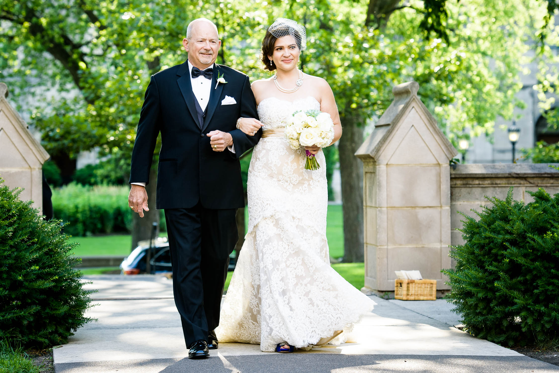 Bride and her father walk down the aisle during a University of Chicago wedding ceremony.