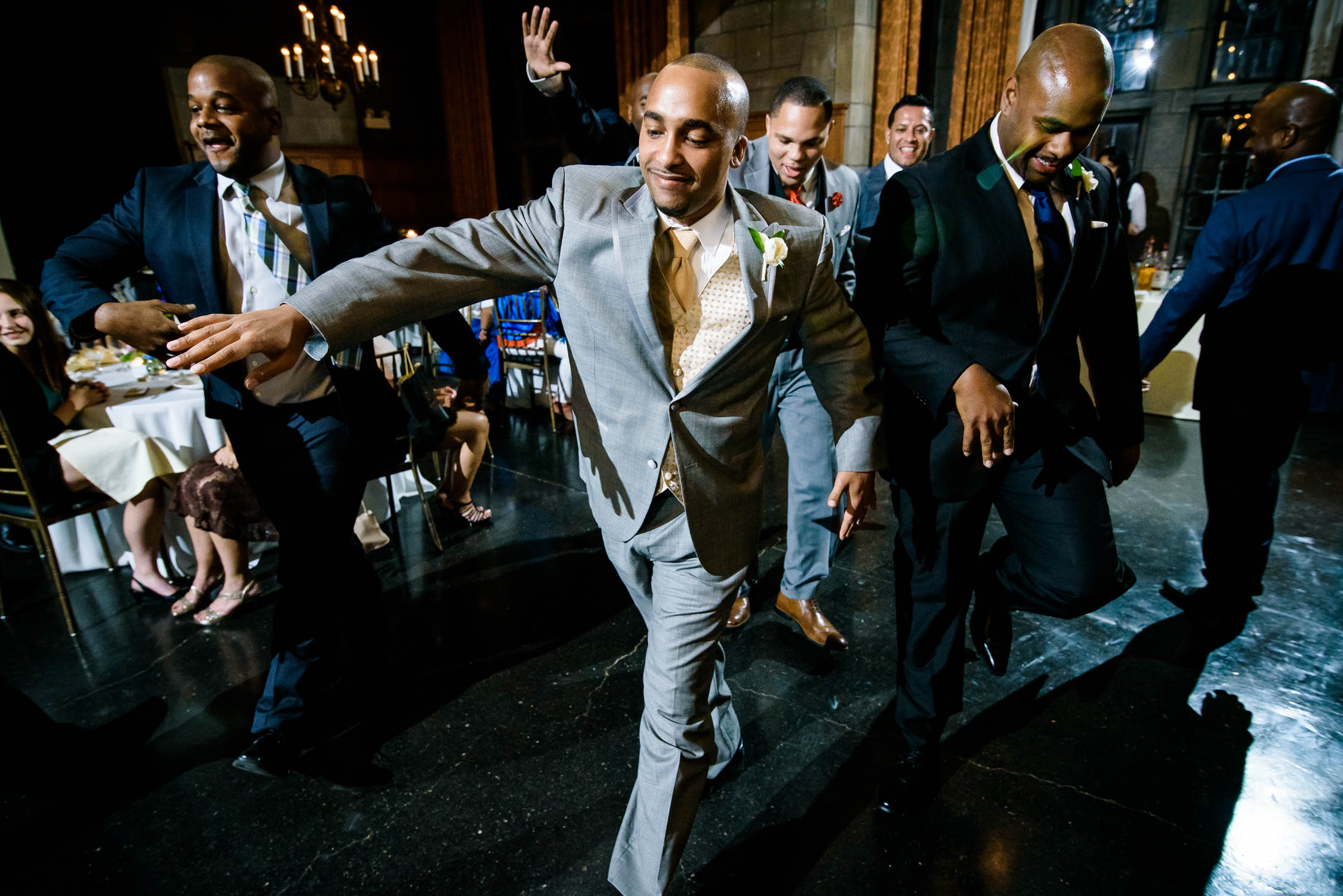 Groom dances with his friends during a Quadrangle Club of Chicago wedding.
