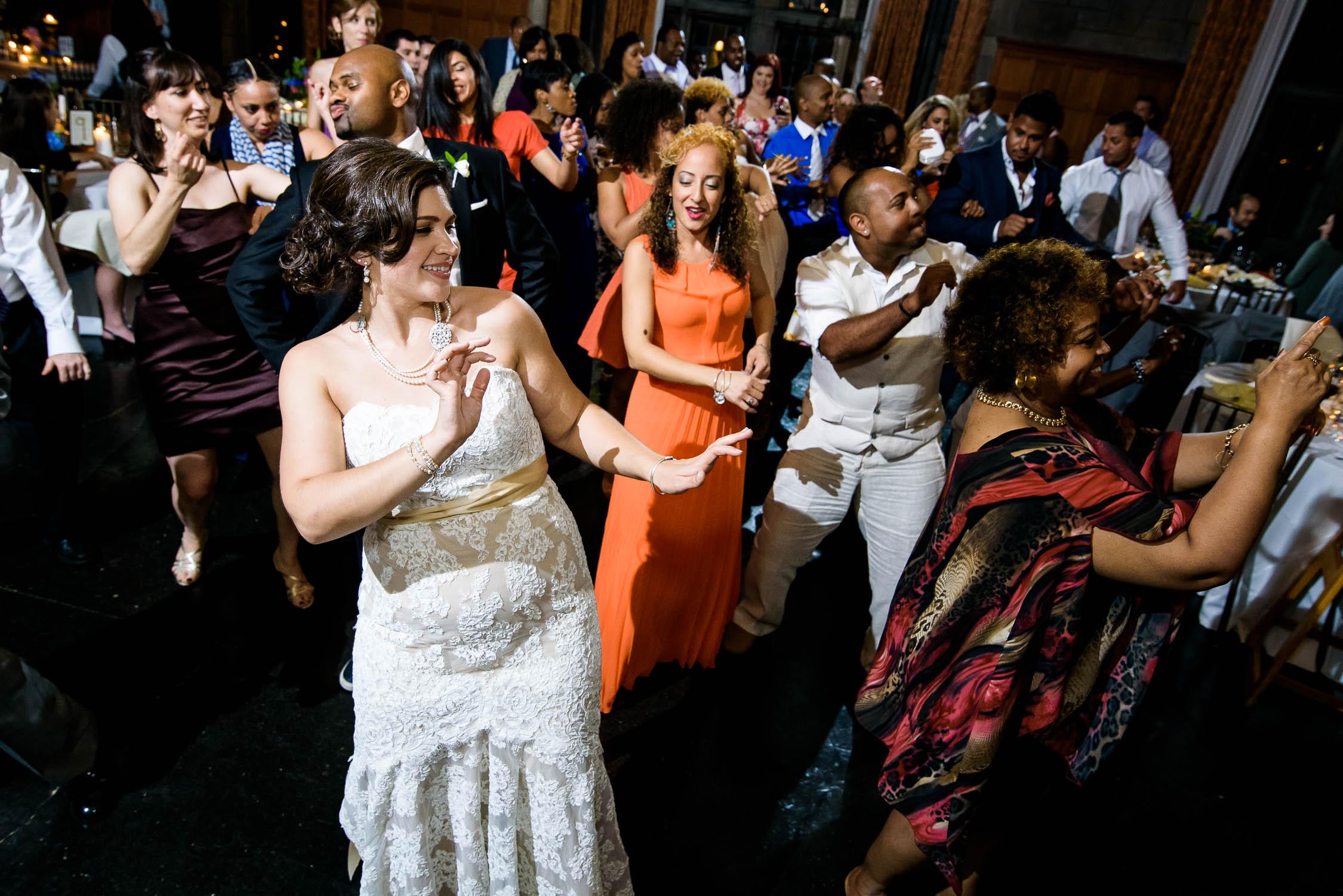 Bride line dances during a Quadrangle Club of Chicago wedding.