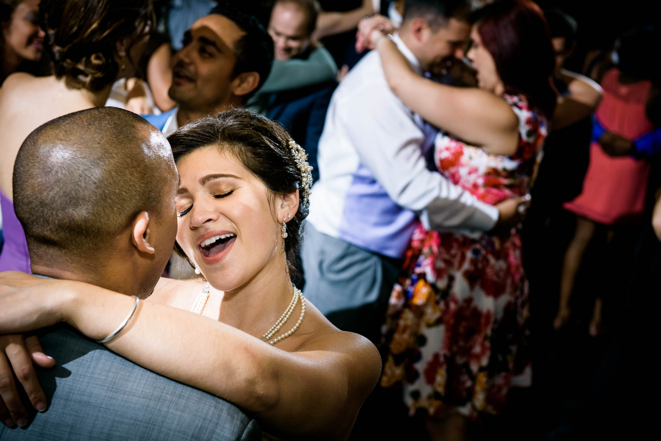 Bride and groom share a moment on the dance floor during their Quadrangle Club of Chicago wedding.