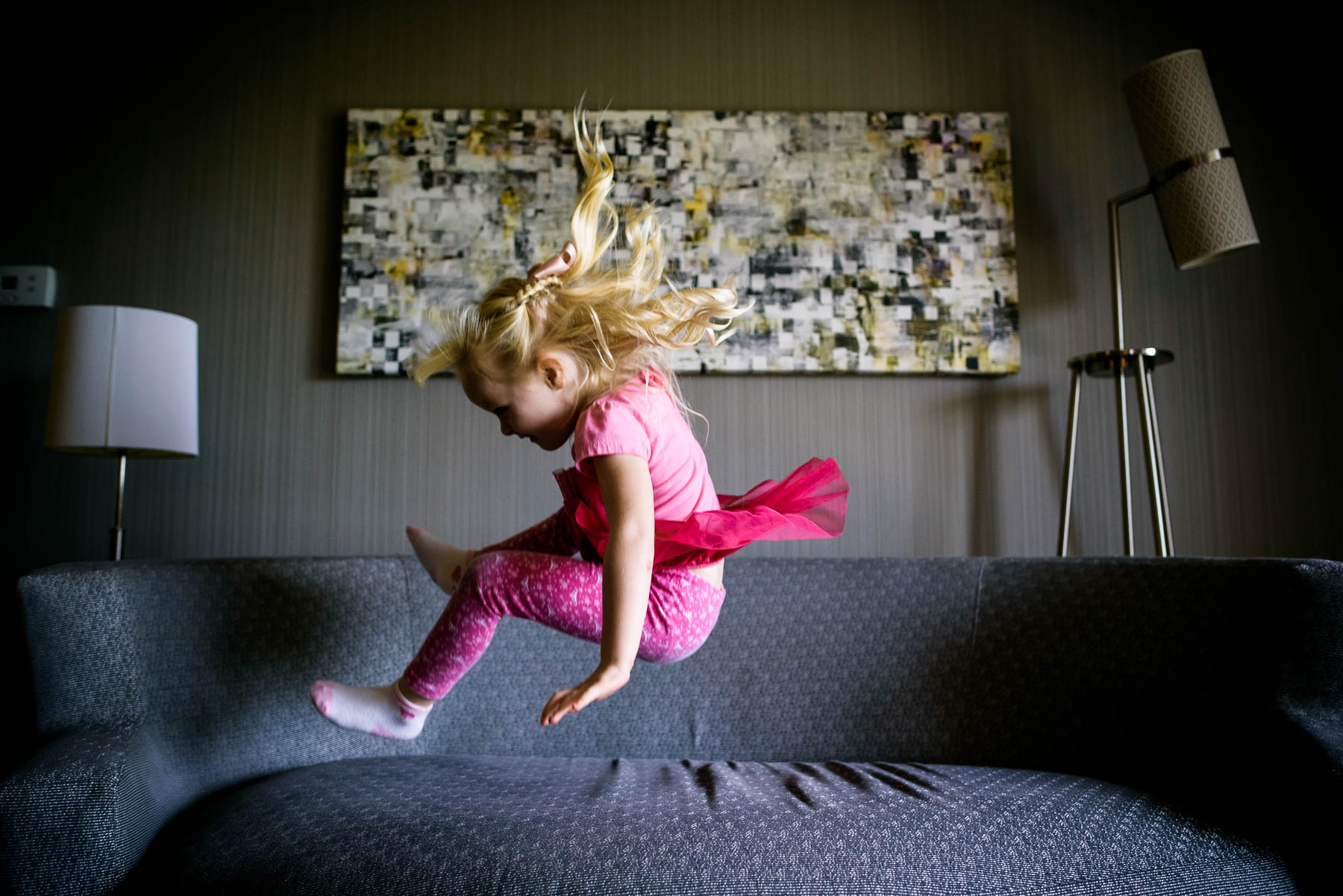 Flower girl bouncing around before a St. Charles Country Club wedding.