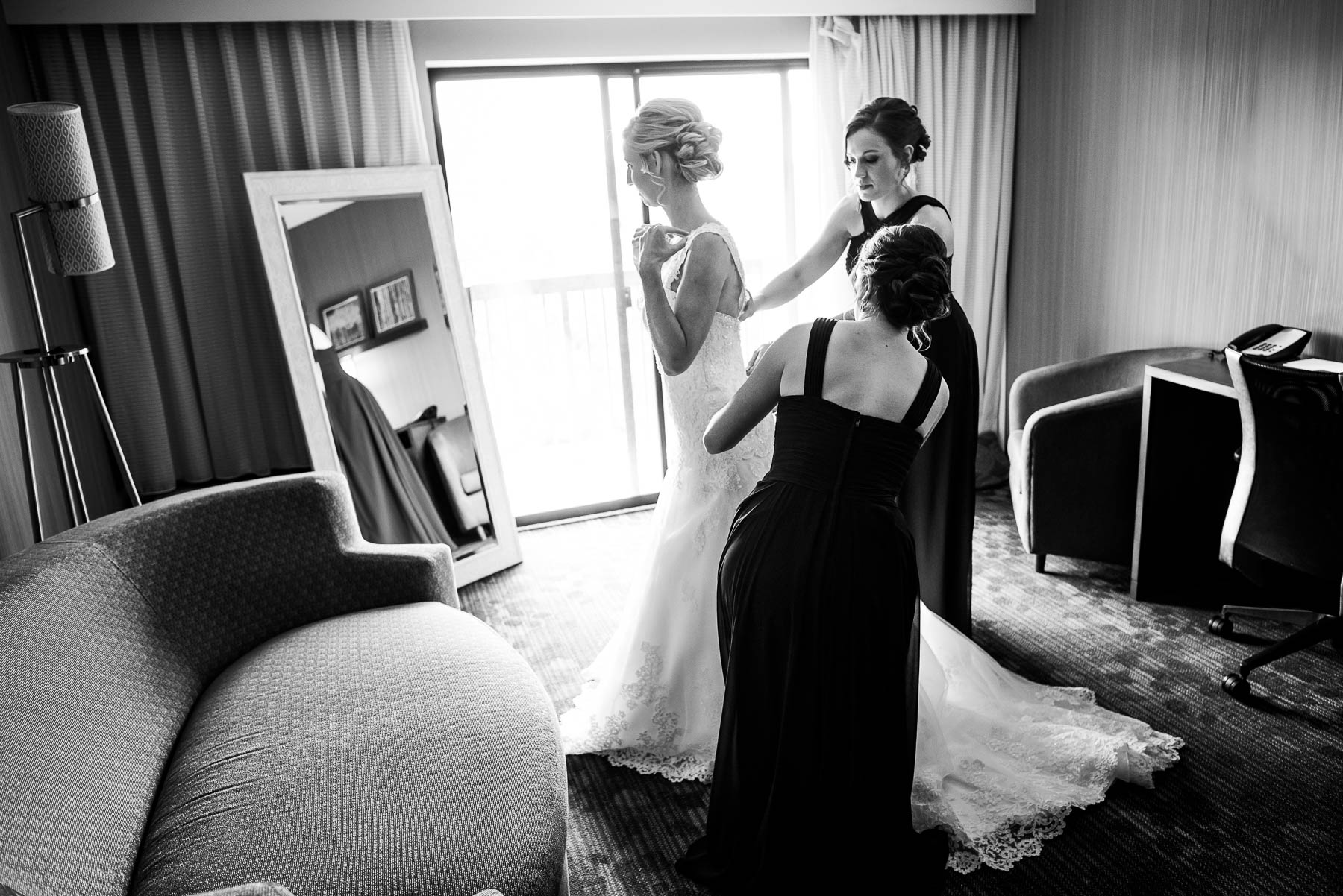 Bridesmaids help the bride get ready on her wedding day.