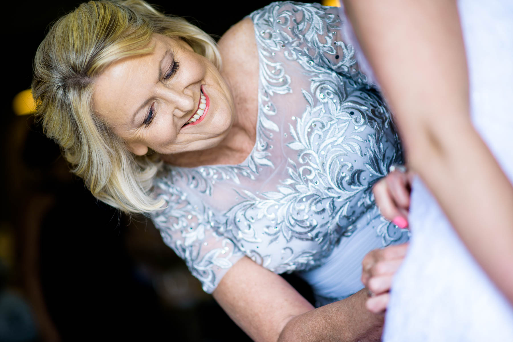 Mom helps her daughter get ready on her wedding day.