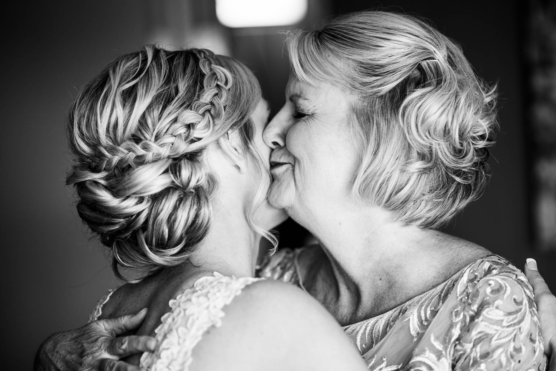 Emotional moment between mother and bride before before a St. Charles Country Club wedding.