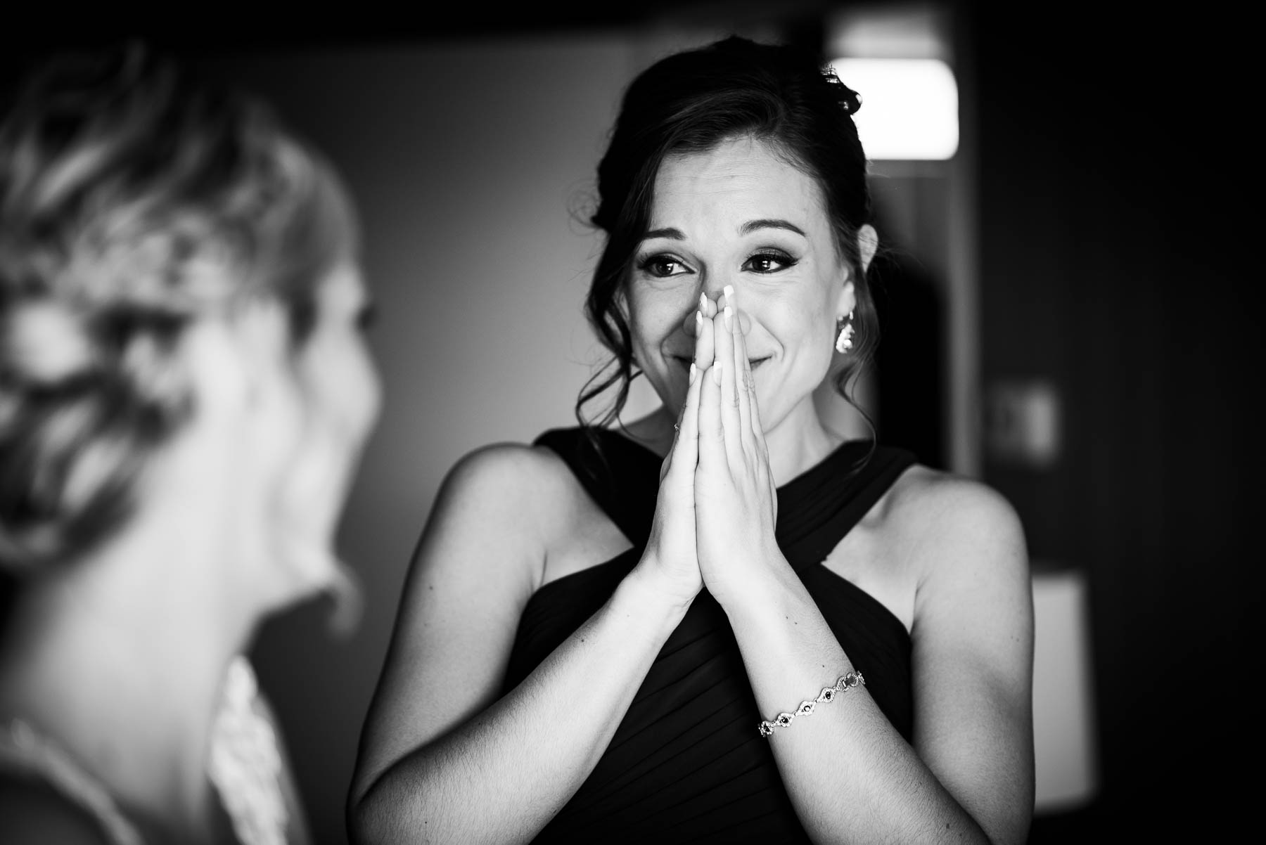Maid of honor reacts emotionally to seeing the bride before her St. Charles Country Club wedding.
