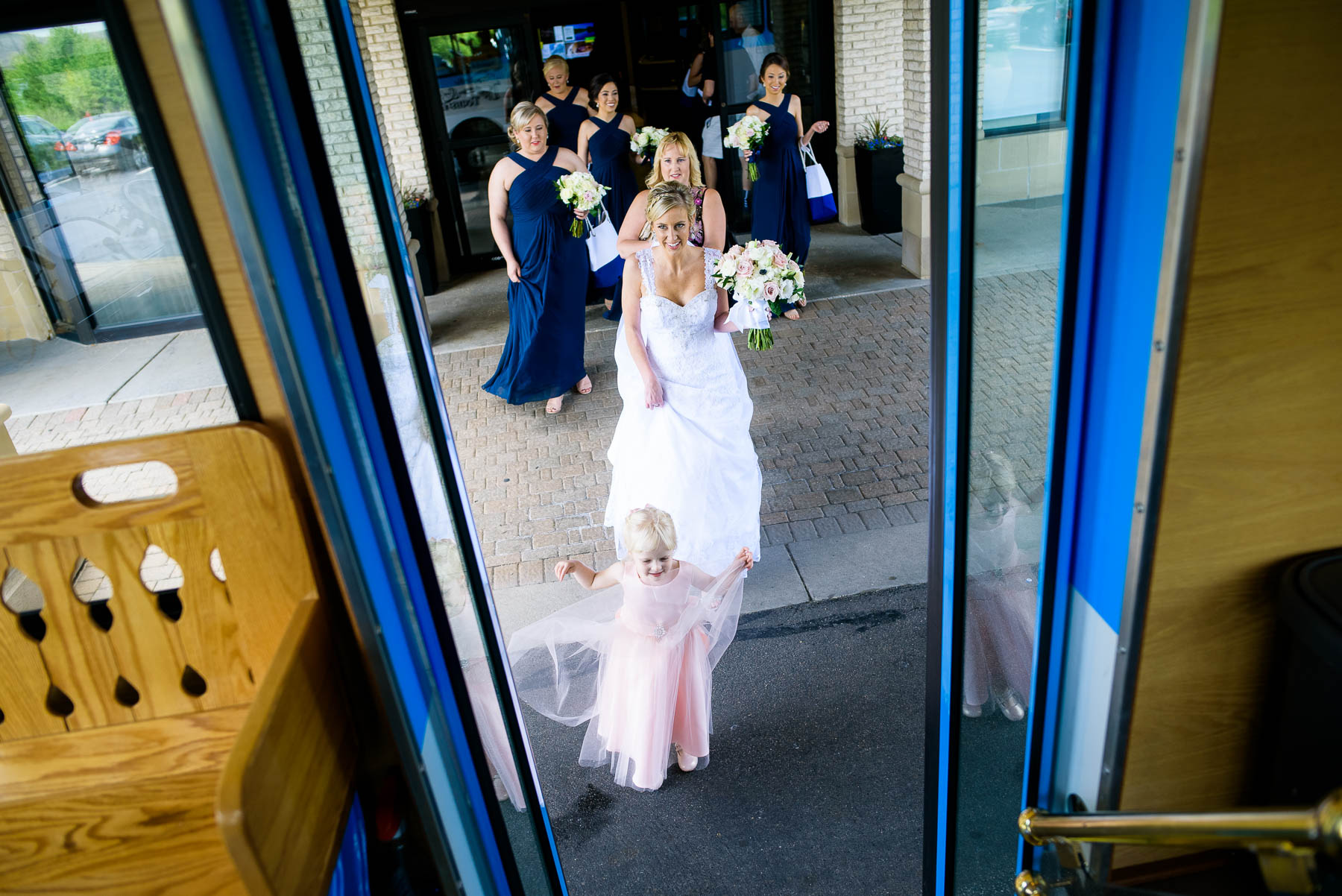 Bridesmaids get on a trolley to the ceremony on the wedding day.