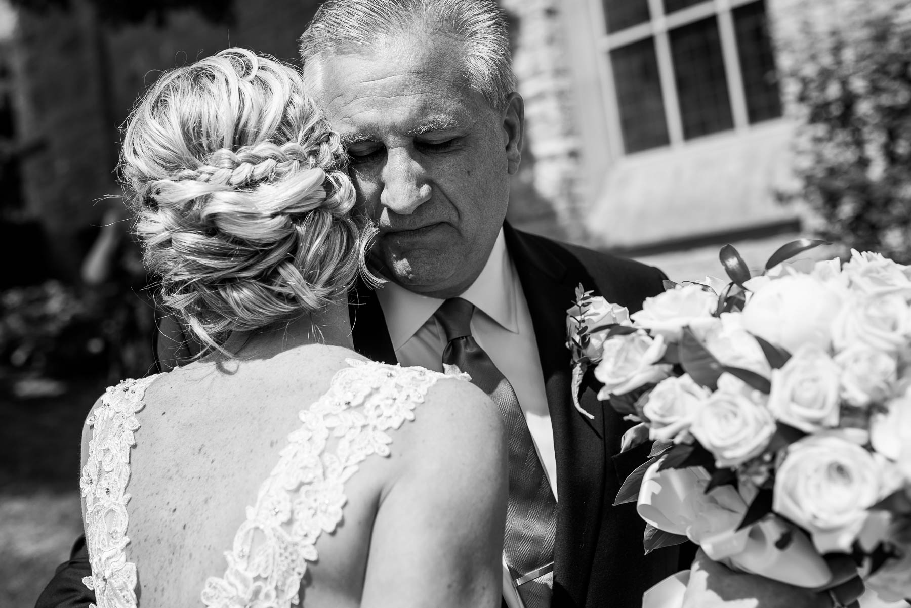 Emotional moment between father and bride before her St. Charles Country Club wedding.
