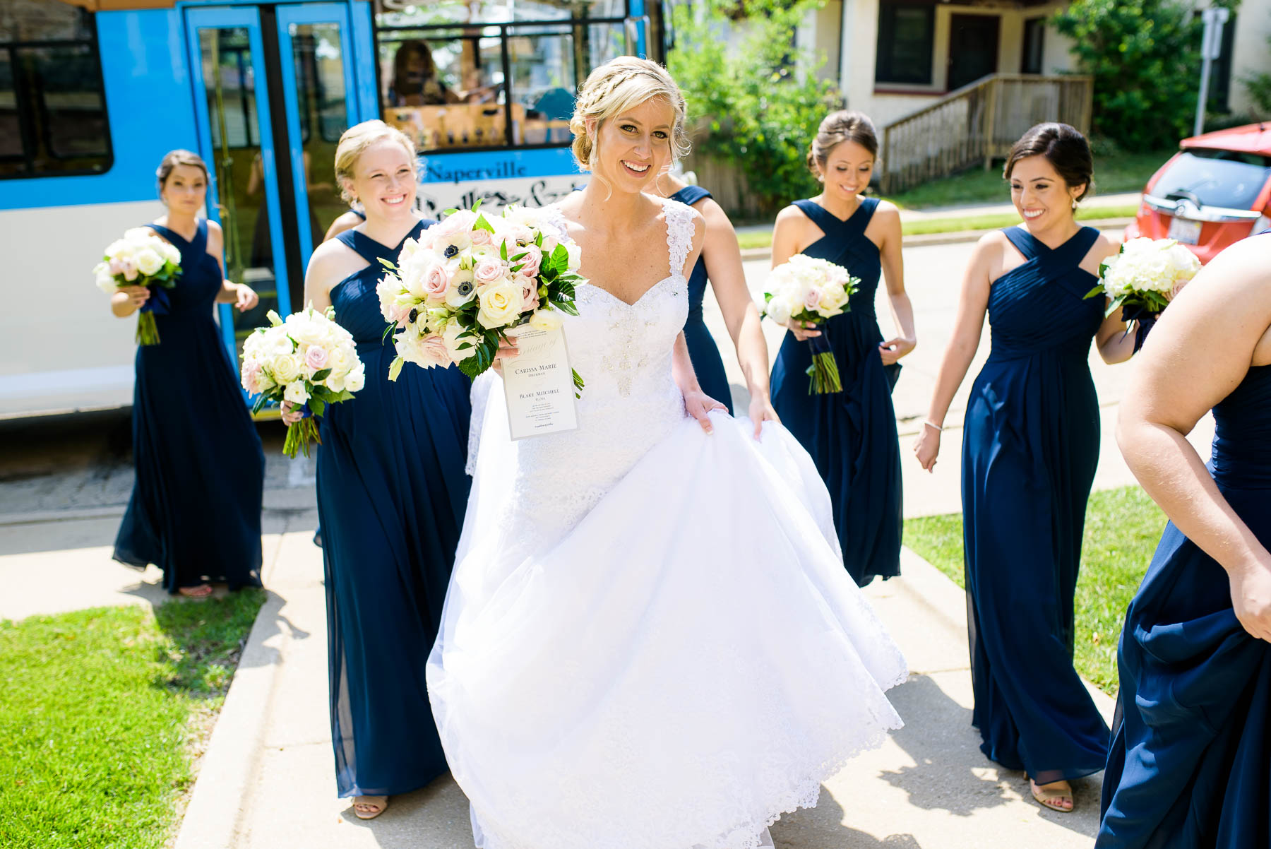 Bride and bridesmaid arrives for her wedding ceremony at Baker Memorial United Methodist Church.