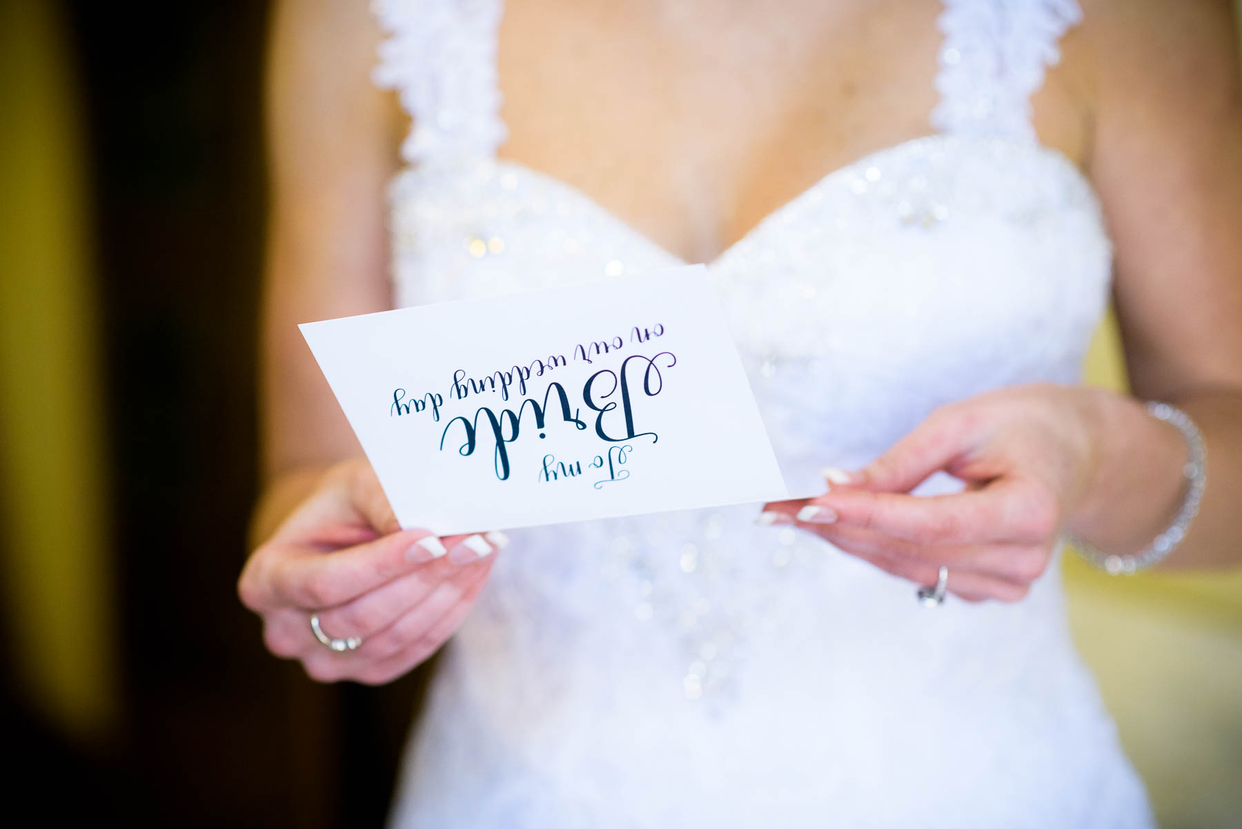 Bride reads a note from the groom before the wedding ceremony at Baker Memorial United Methodist Church in St. Charles