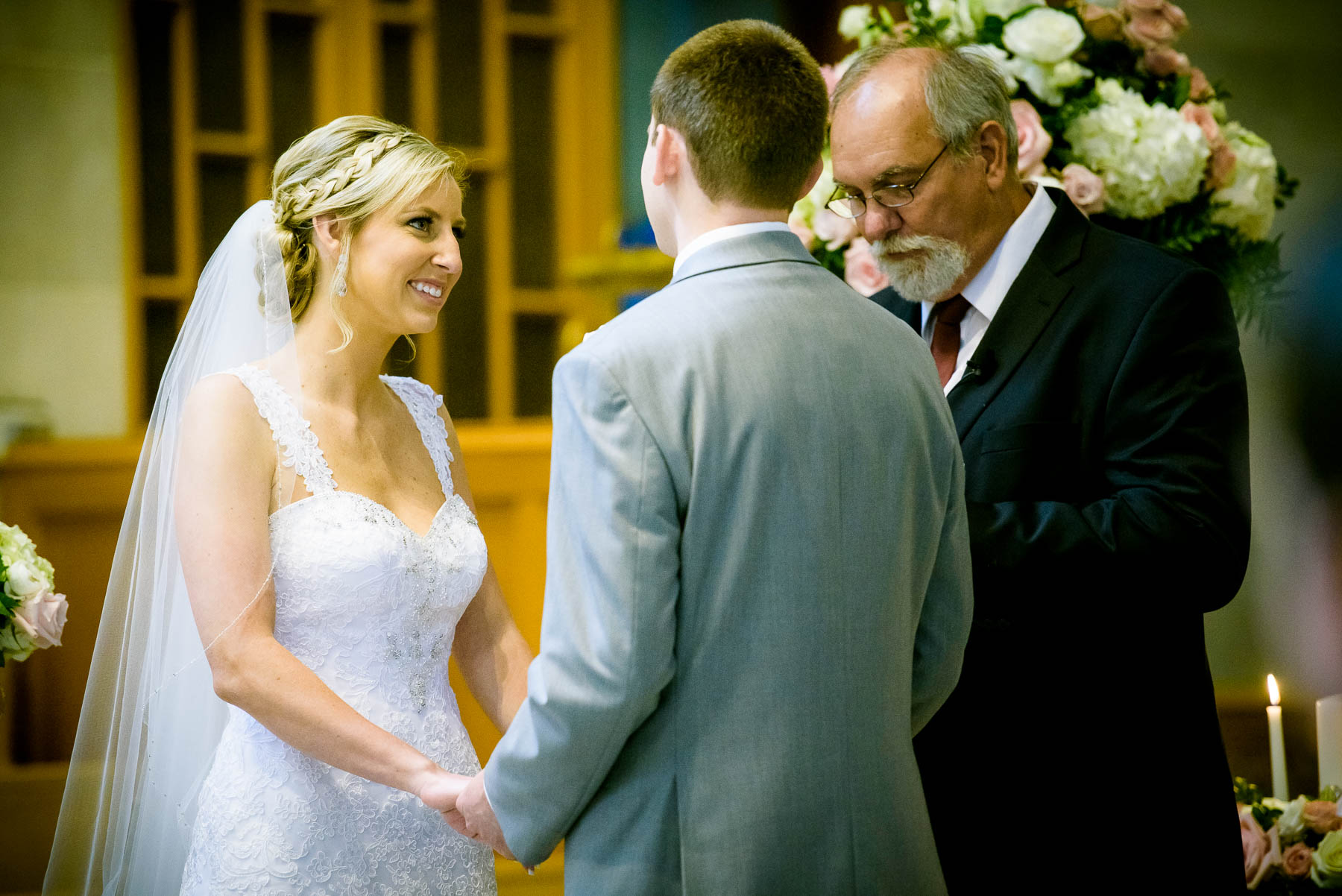 Bride and groom during their wedidng ceremony at Baker Memorial United Methodist Church in St. Charles