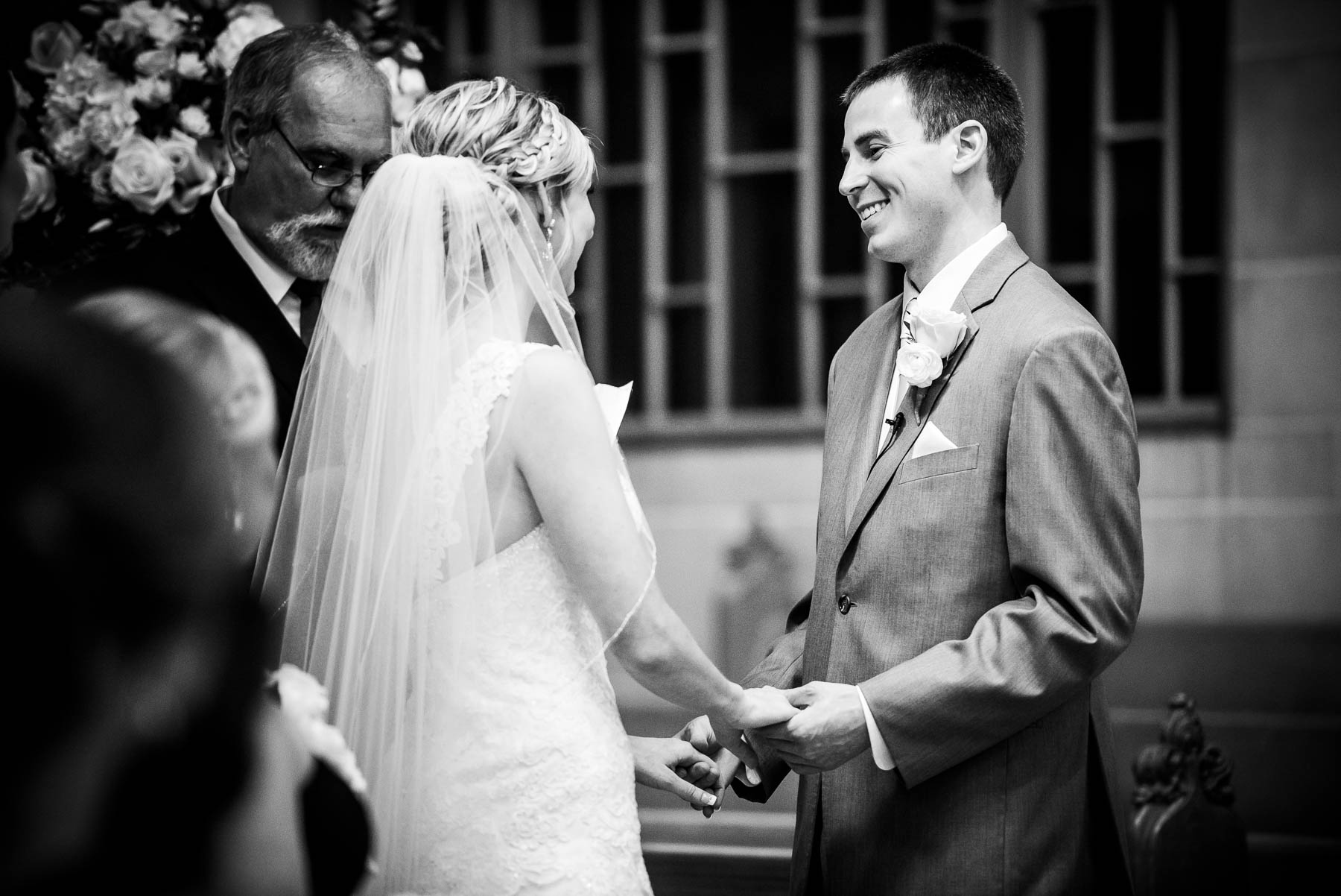Groom smiles at the bride during their wedding ceremony at Baker Memorial United Methodist Church in St. Charles