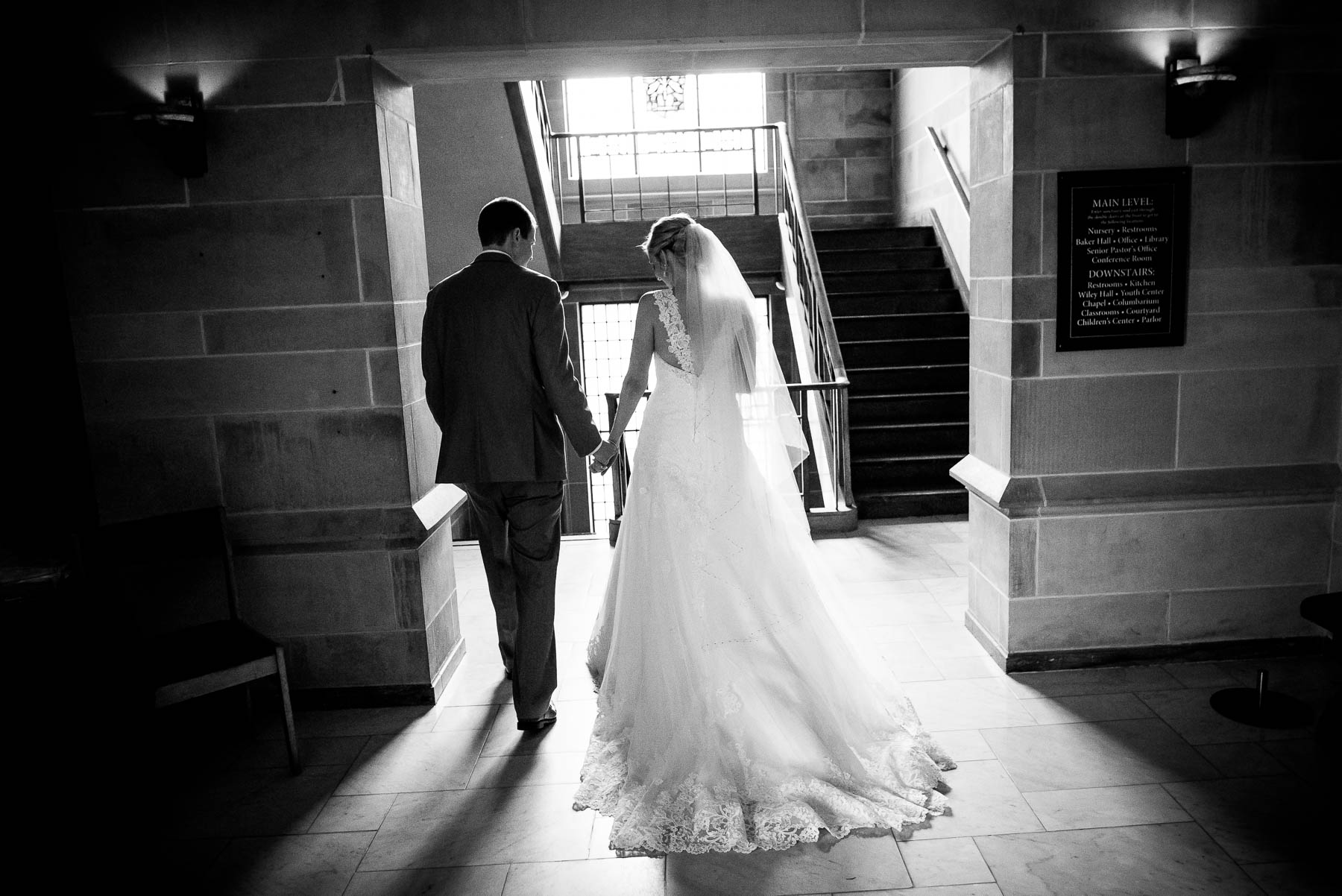 Bride and groom spend a moment alone after their wedding ceremony at Baker Memorial United Methodist Church in St. Charles