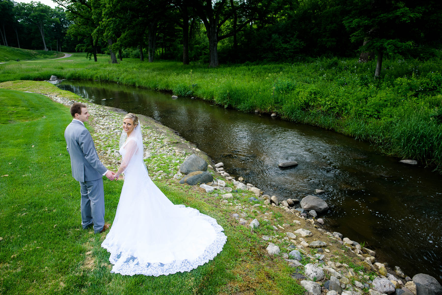 Portrait of the couple during their St. Charles Country Club wedding.