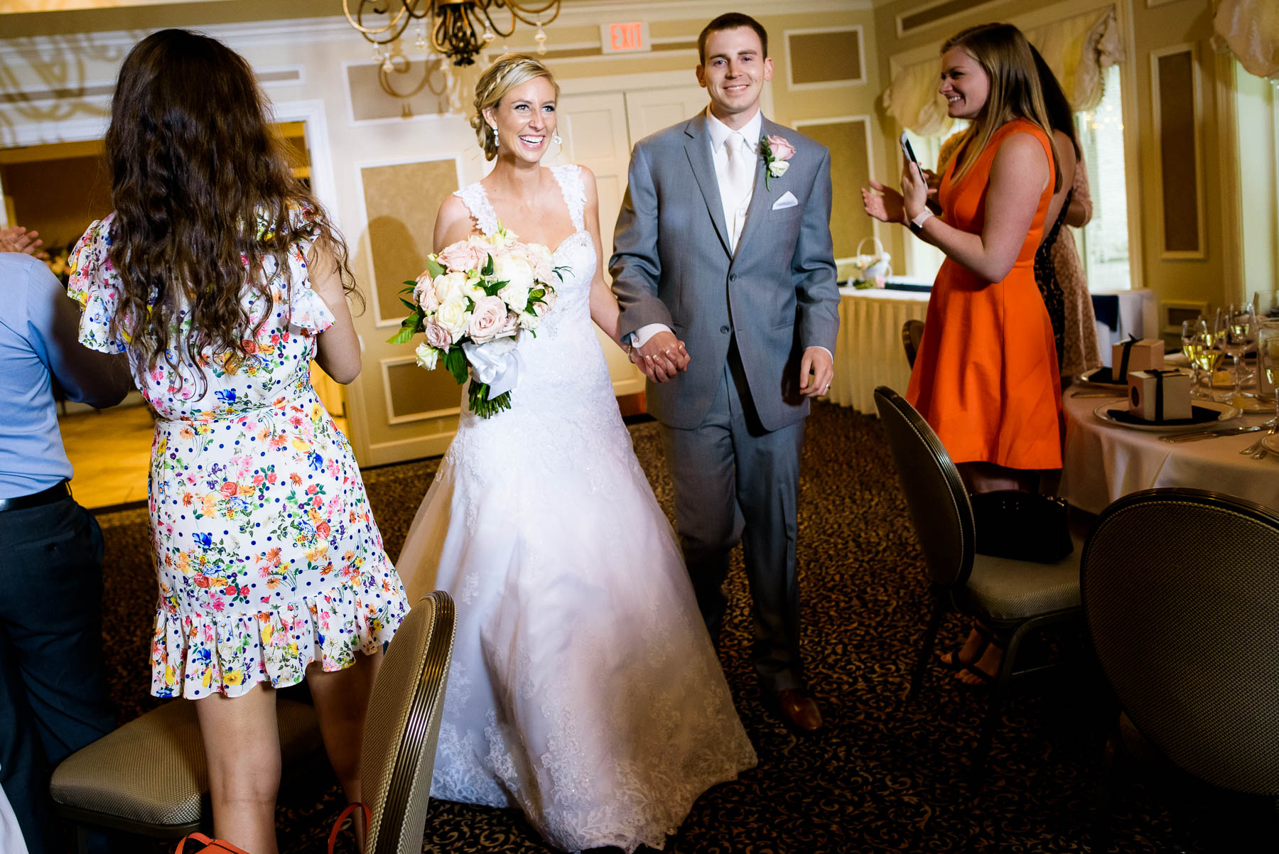 Bride and groom are introduced at the St. Charles Country Club wedding.