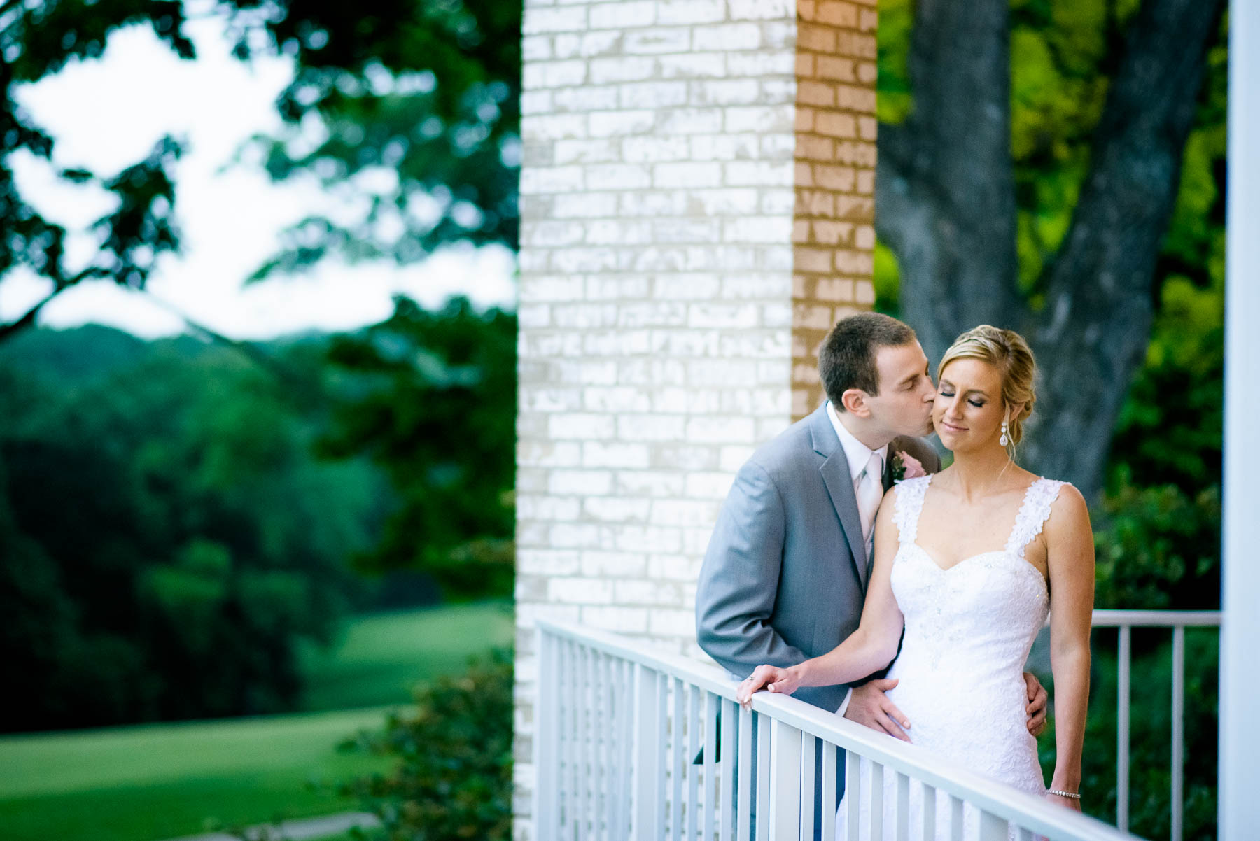 Portrait at dusk of the bride and groom during their St. Charles Country Club wedding.