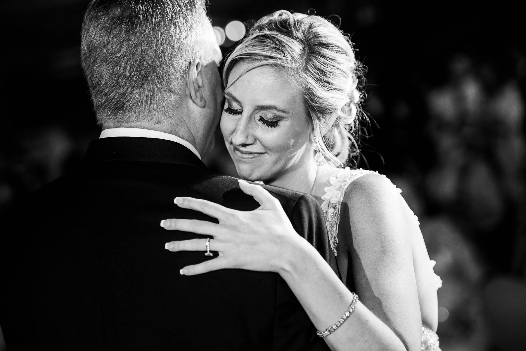 Bride hugs her father during their dance at a St. Charles Country Club wedding.