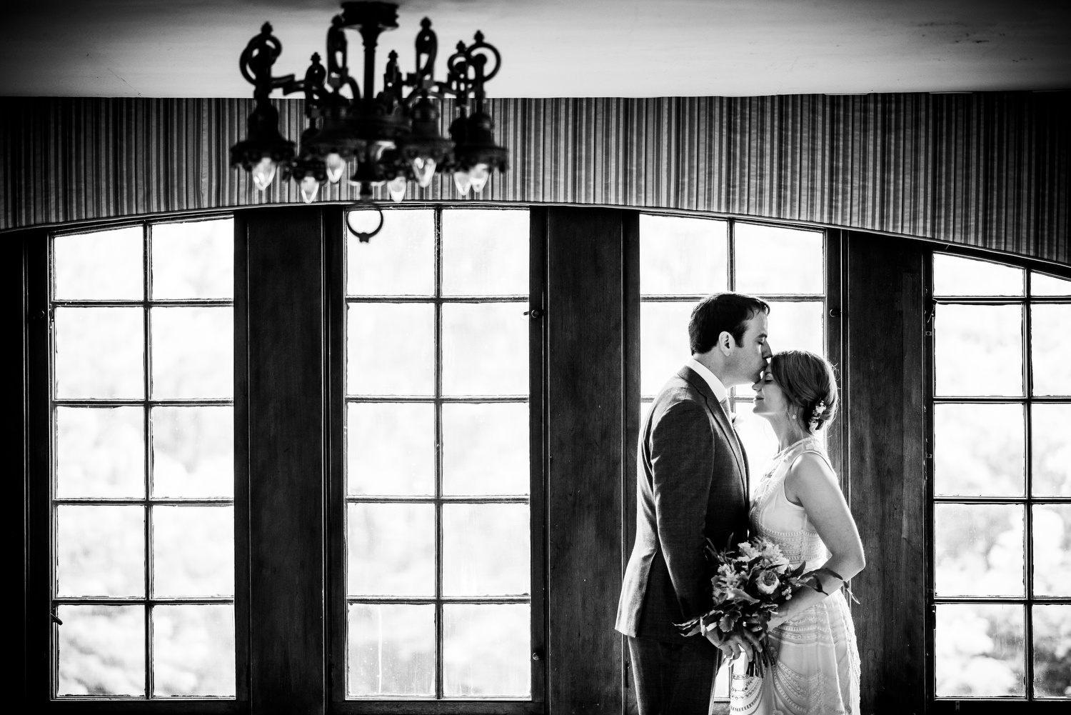 Bride & groom kiss during their wedding at the Cheney Mansion in Oak Park.