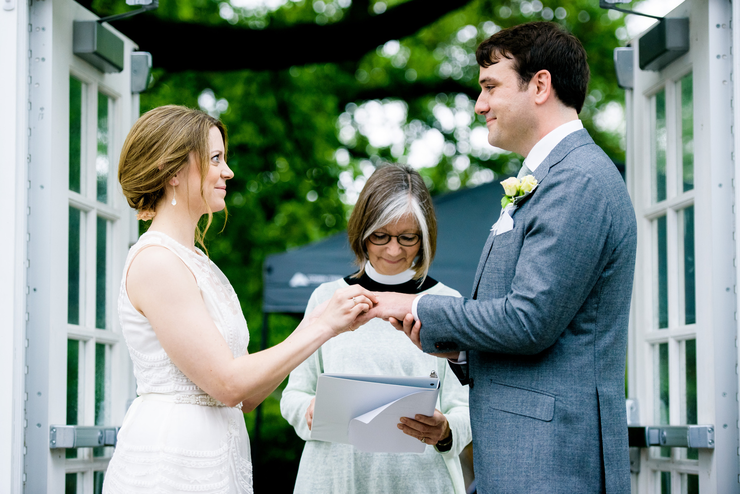 Ring exchange during a Cheney Mansion wedding in Oak Park.
