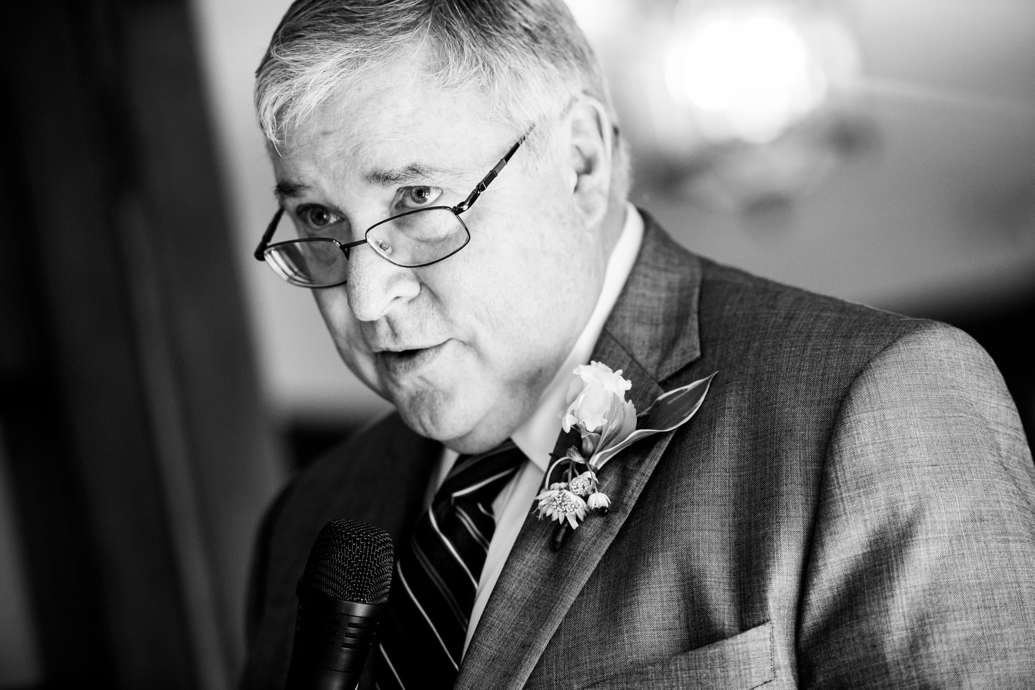 Father of the bride makes a speech during a Cheney Mansion wedding in Oak Park.