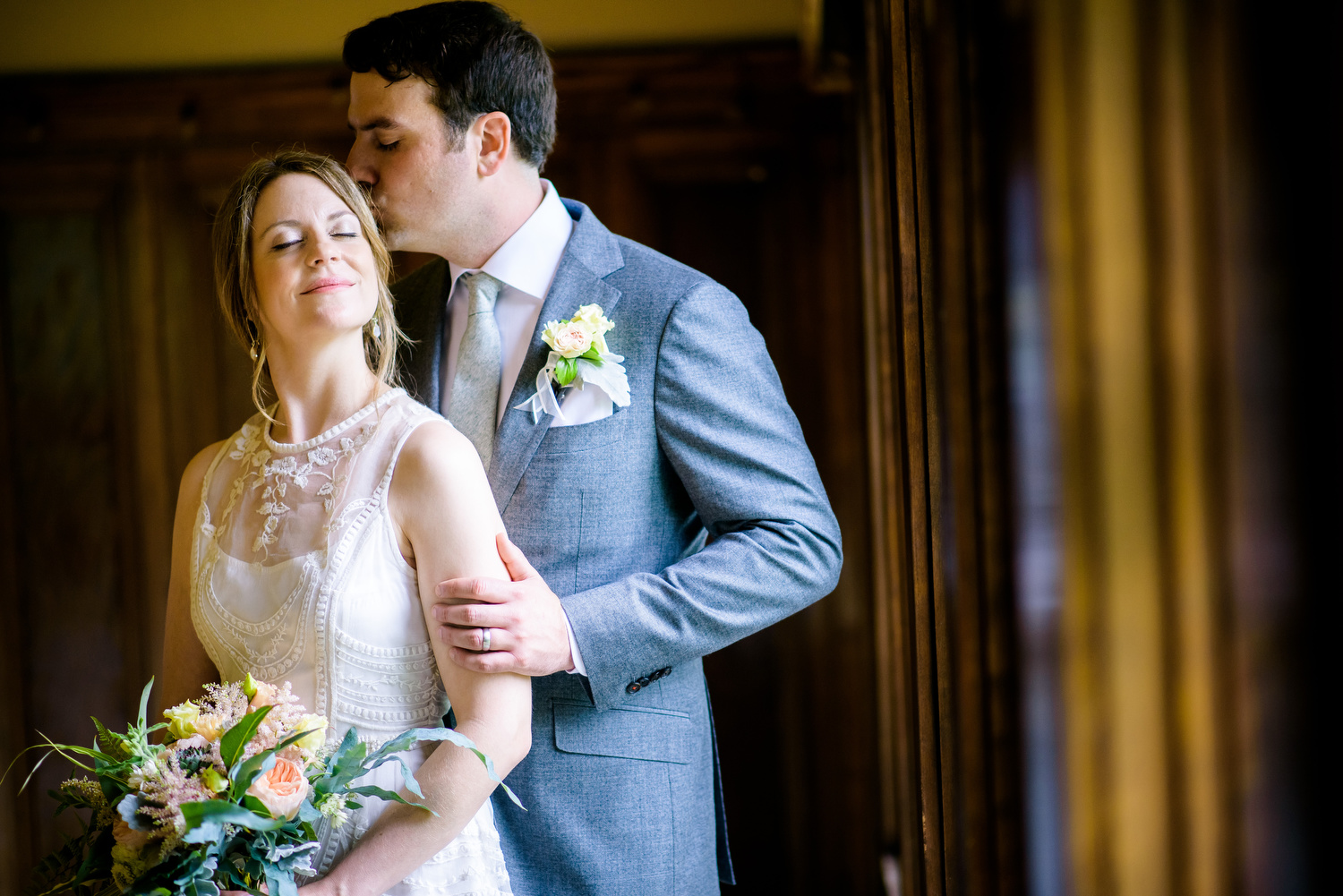 Indoor portrait of the bride and groom during a Cheney Mansion wedding in Oak Park.
