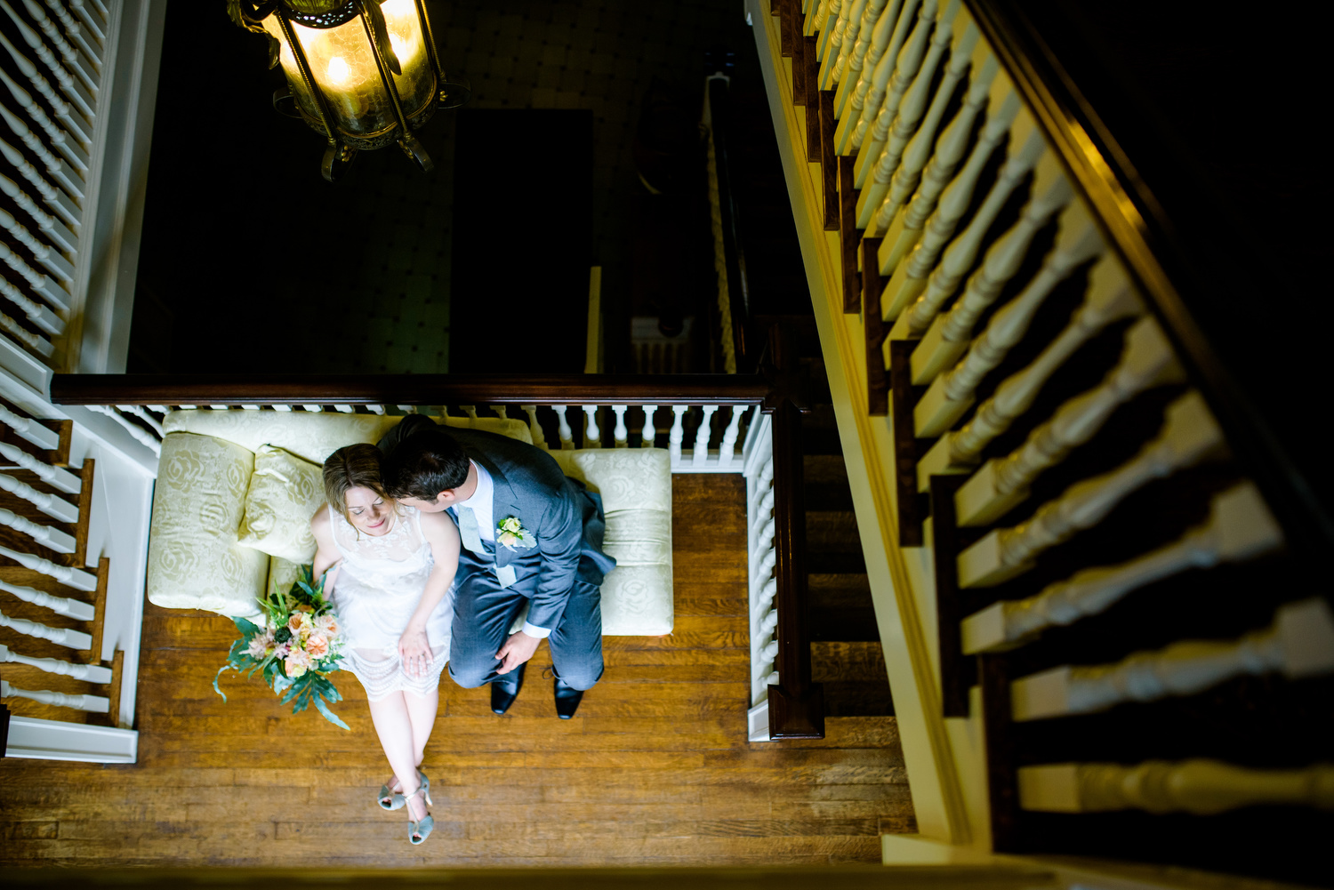 Creative indoor portrait of the couple during a Cheney Mansion wedding in Oak Park.