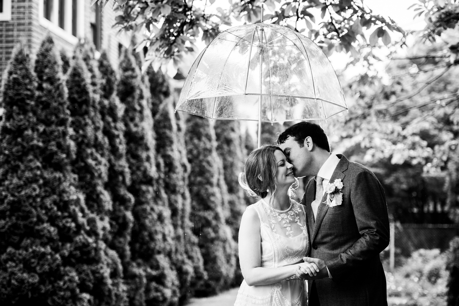 Outdoor rainy day portrait of the bride and groom during a Cheney Mansion wedding in Oak Park.