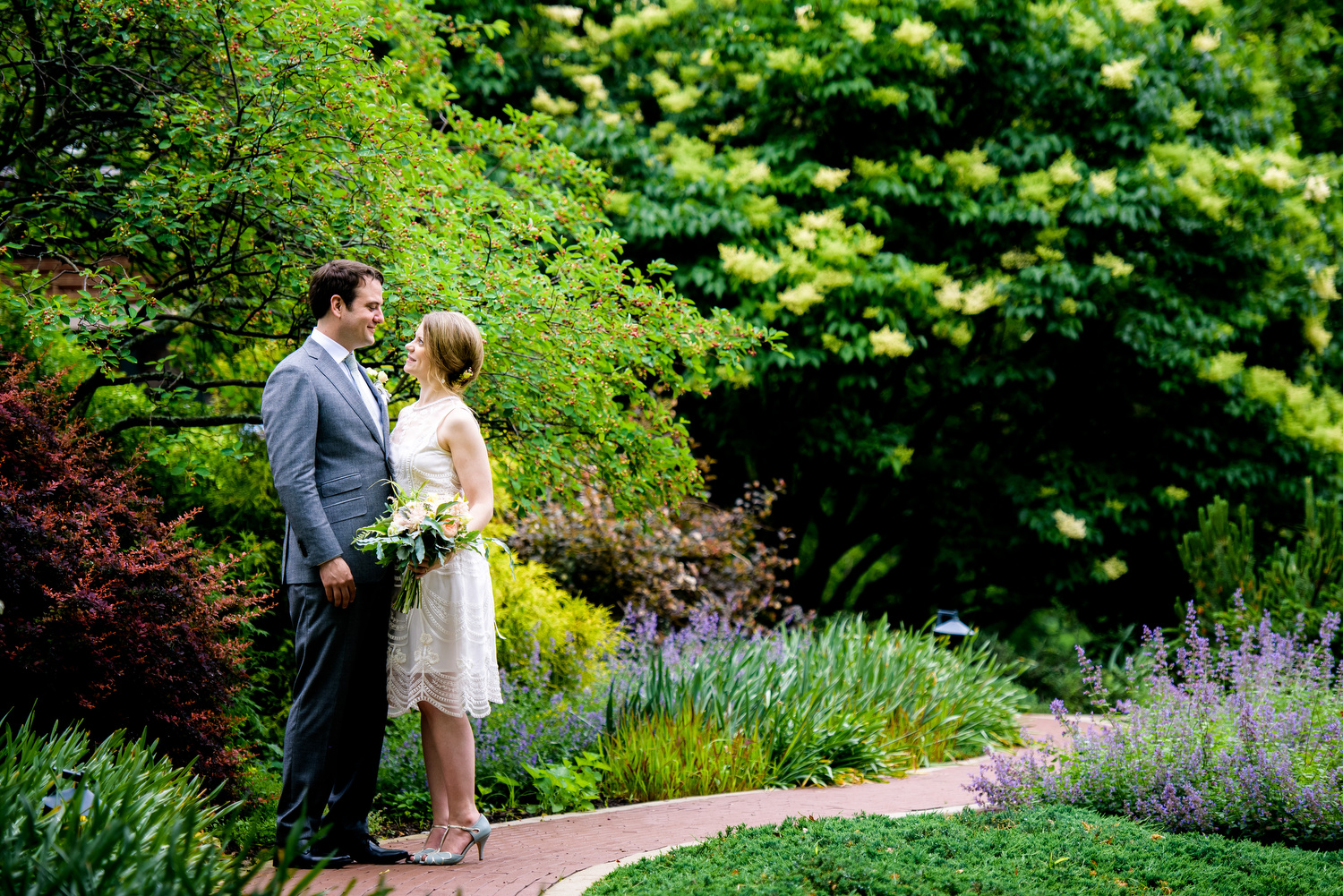 Photo of bride and groom in the gardens during a Cheney Mansion wedding in Oak Park.