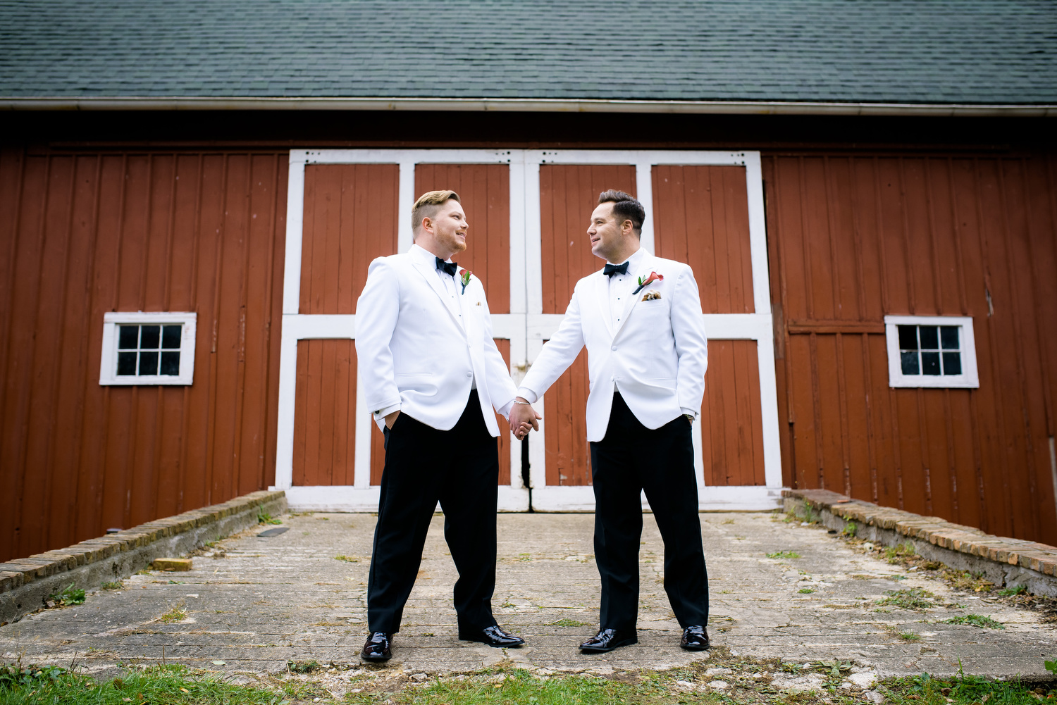 Wedding portrait of the grooms during a same sex wedding at Heritage Prairie Farm.