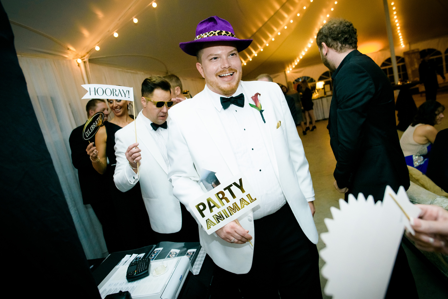 Funny reception moment during a wedding at at Heritage Prairie Farm.