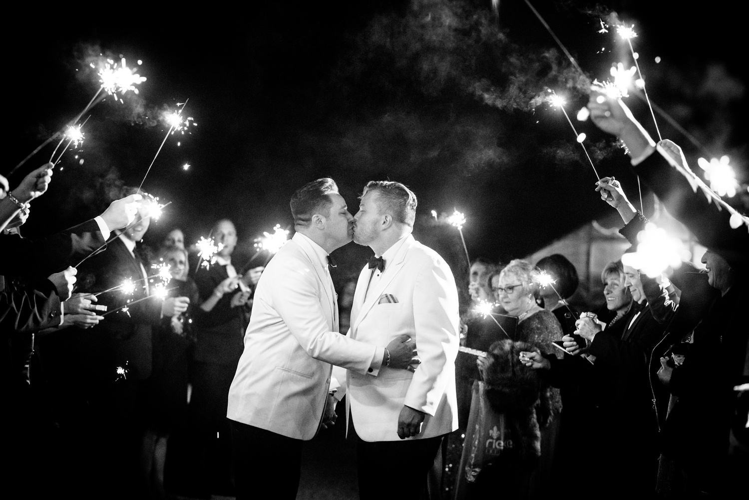 Sparkler exit during a same sex wedding at Heritage Prairie Farm.