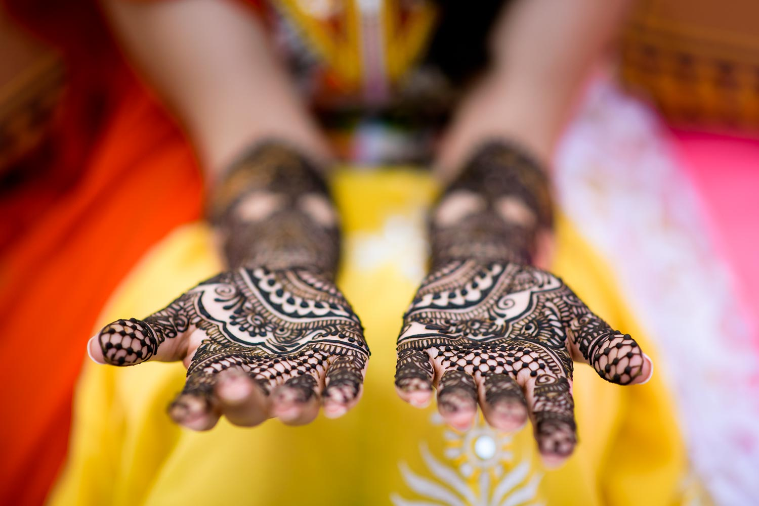 Henna by Henna Moments during an Indian wedding mehndi in South Barrington, Illinois.