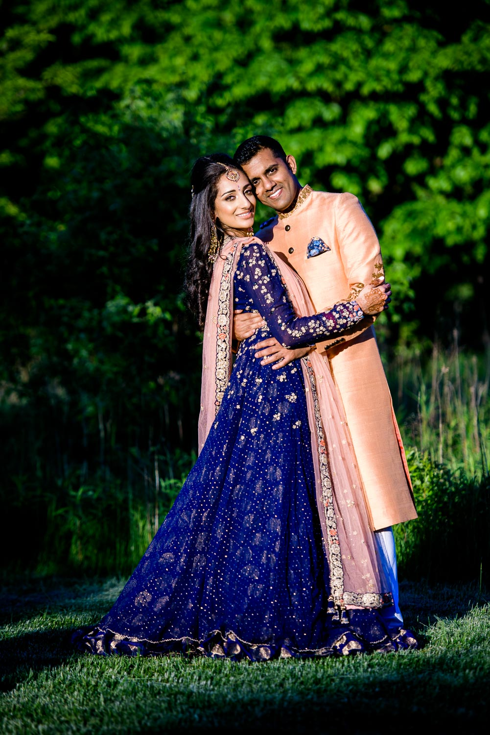 Bride and groom during their Indian wedding sangeet at Stonegate Banquets in Hoffman Estates.