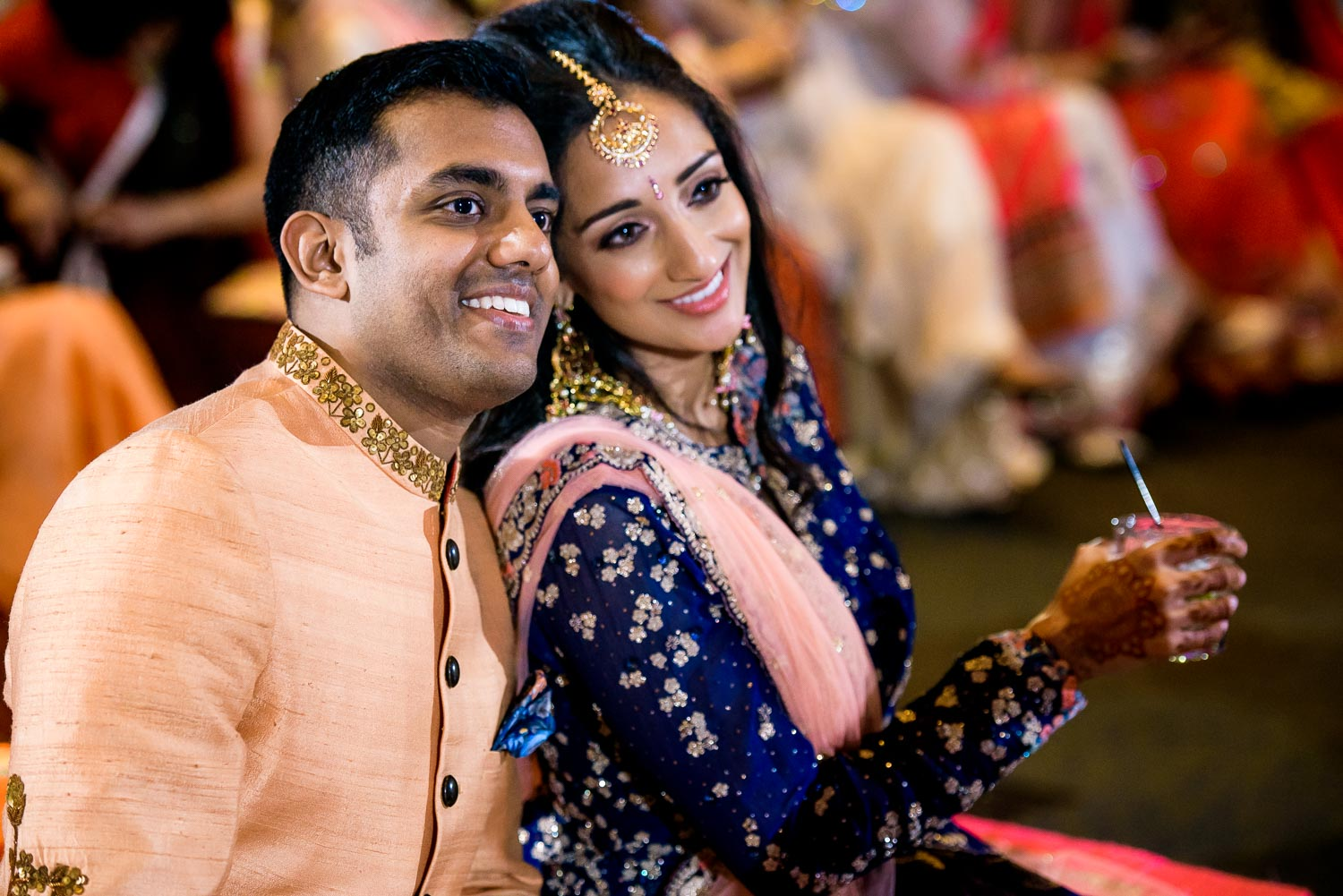 Bride and groom watch the performances during an Indian wedding sangeet at Stonegate Banquets in Hoffman Estates.