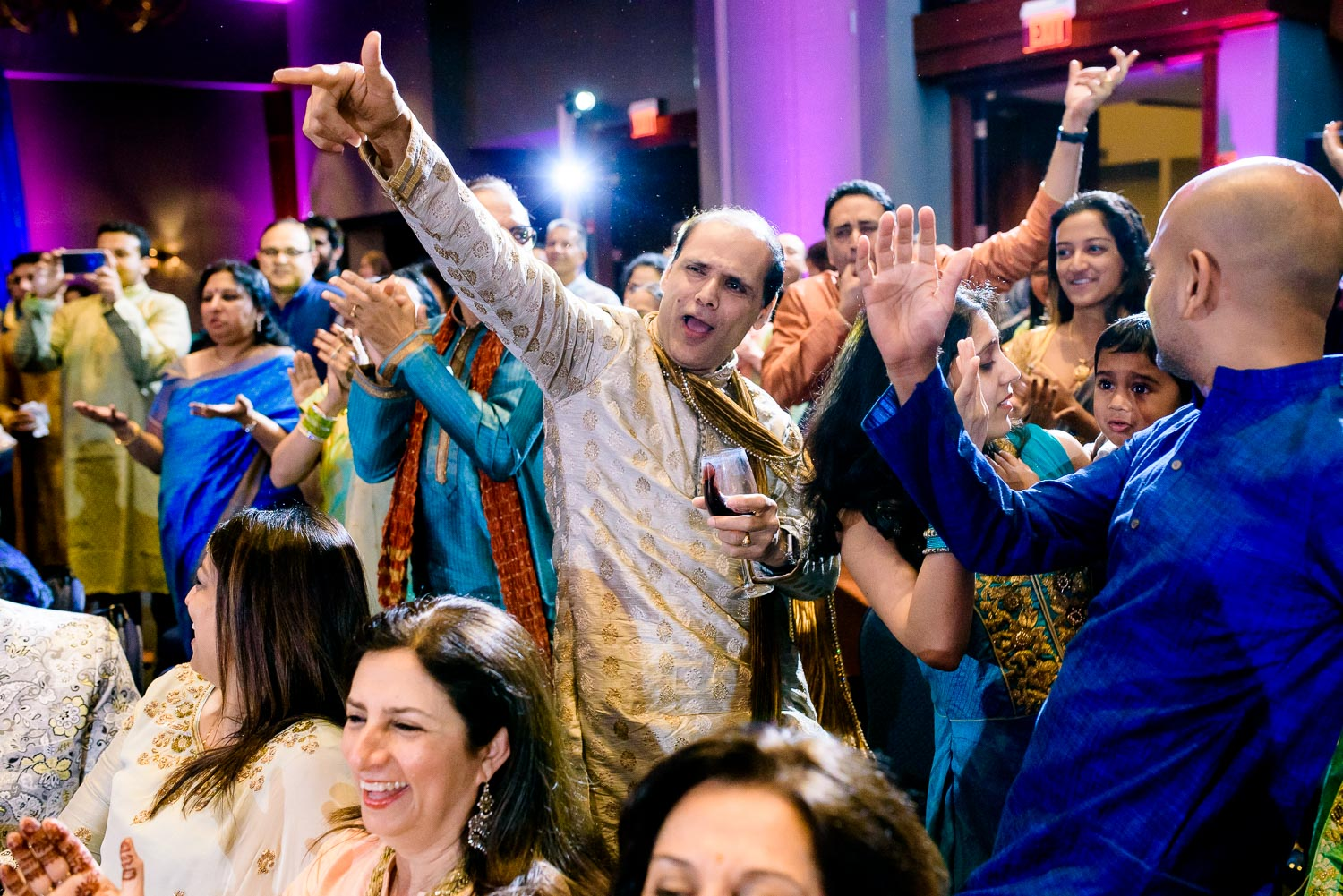 The crowd celebrates during an Indian wedding sangeet at Stonegate Banquets in Hoffman Estates.