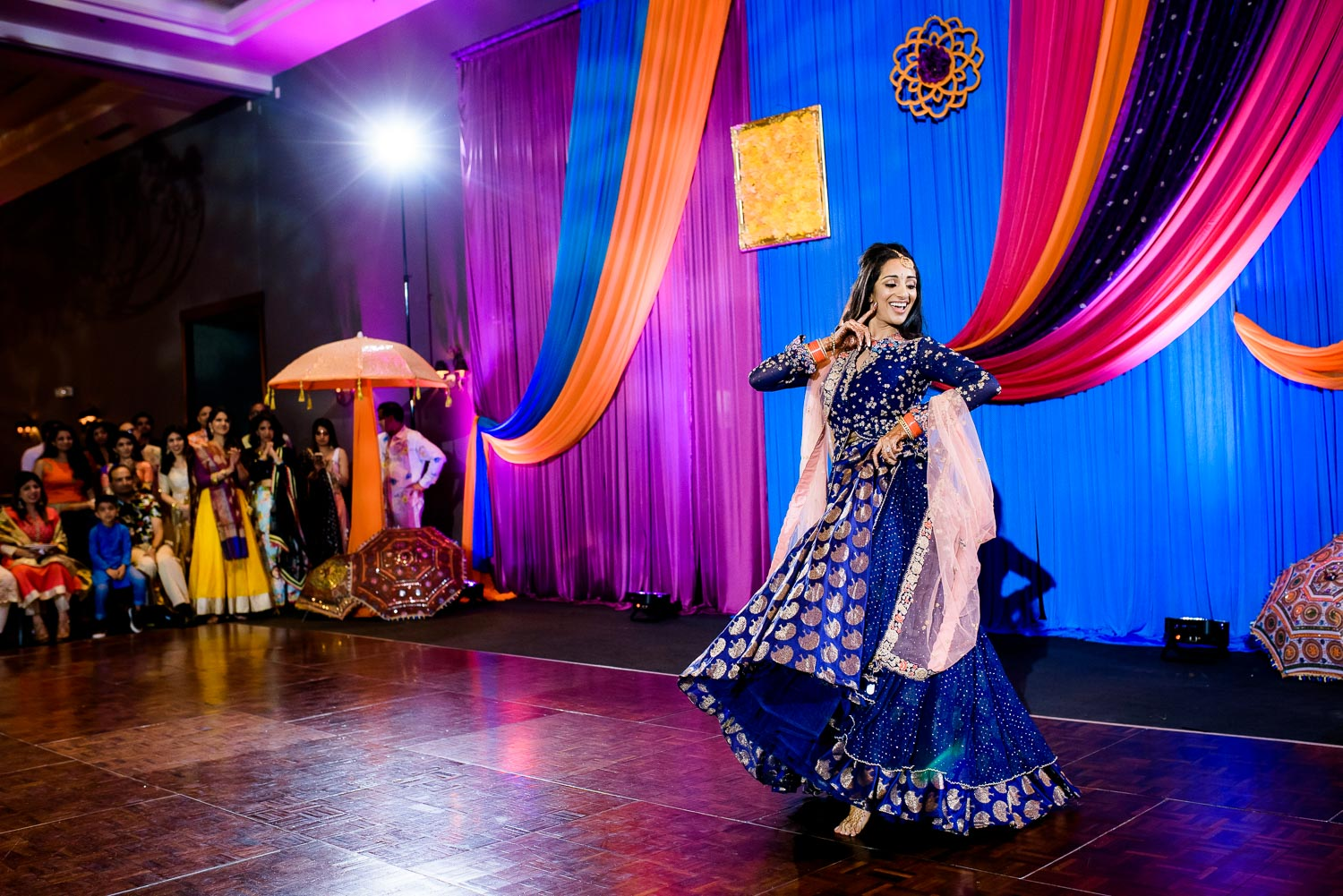 The bride dances during an Indian wedding sangeet at Stonegate Banquets in Hoffman Estates.