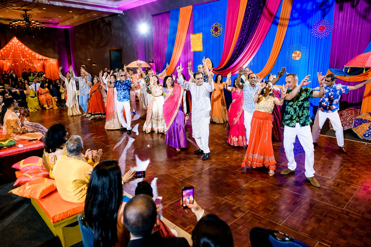 Aunts and uncles performance during an Indian wedding sangeet at Stonegate Banquets in Hoffman Estates.