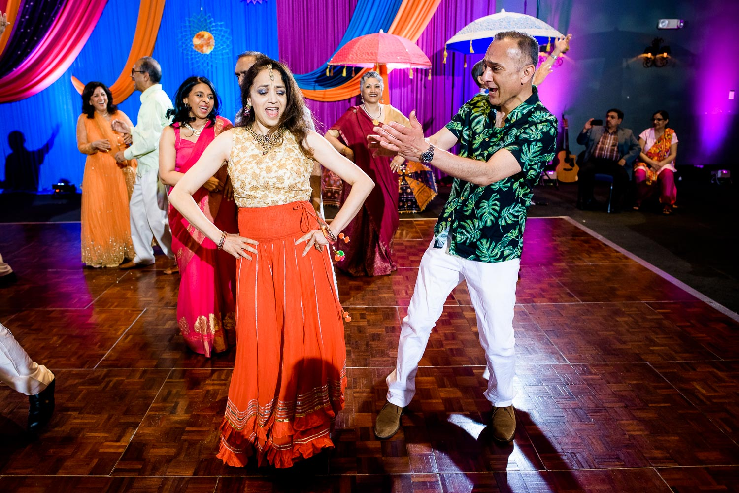 Aunts and uncles dance during an Indian wedding sangeet at Stonegate Banquets in Hoffman Estates.