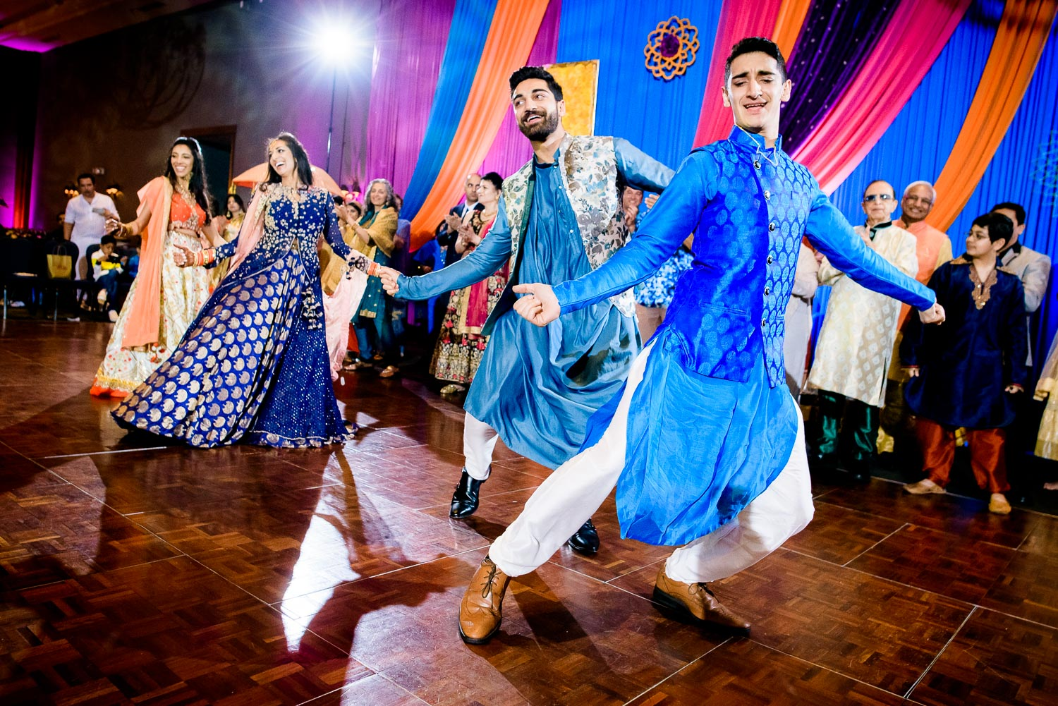 Bride and siblings dance during an Indian wedding sangeet at Stonegate Banquets in Hoffman Estates.